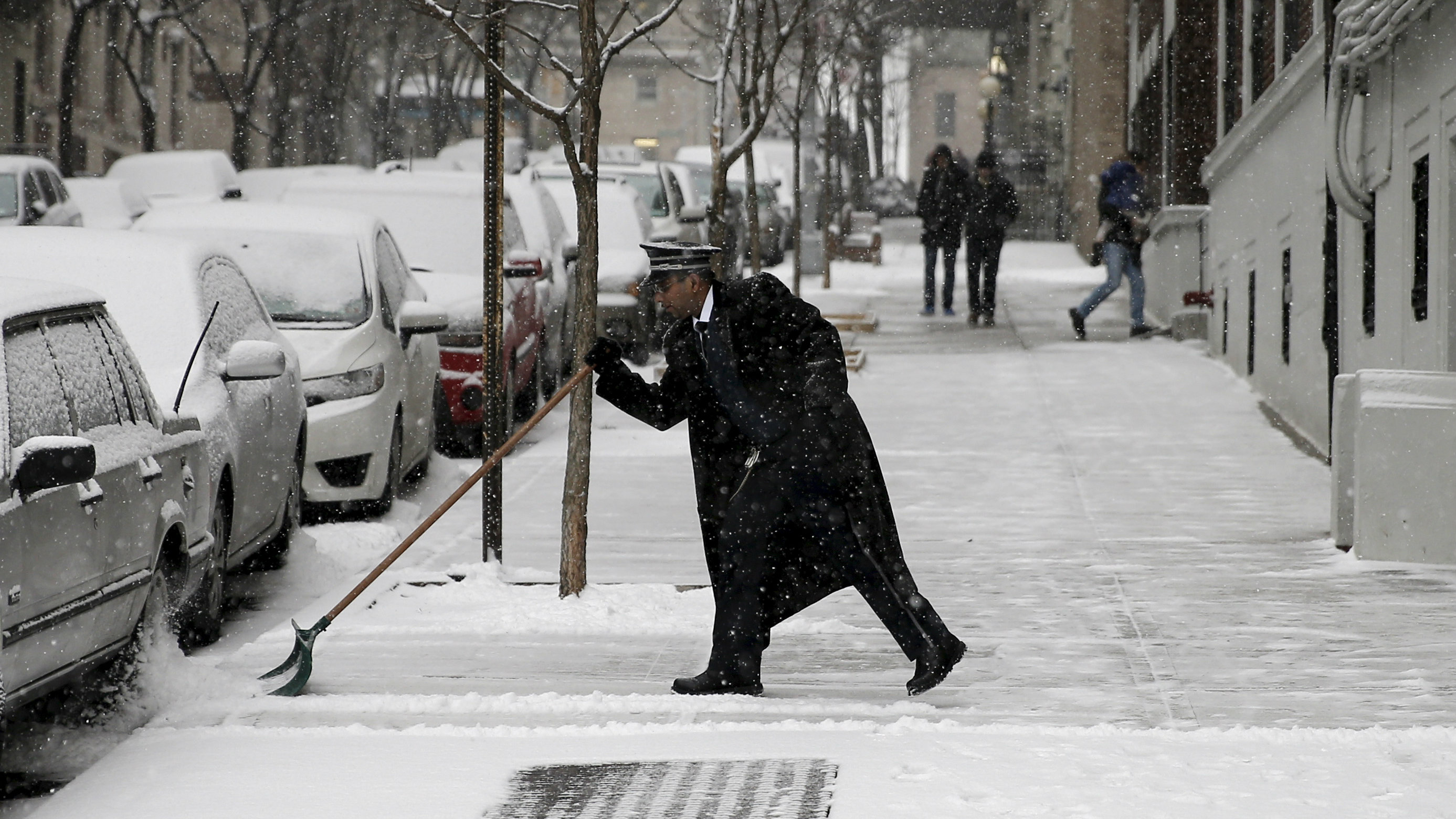 doorman shoveling