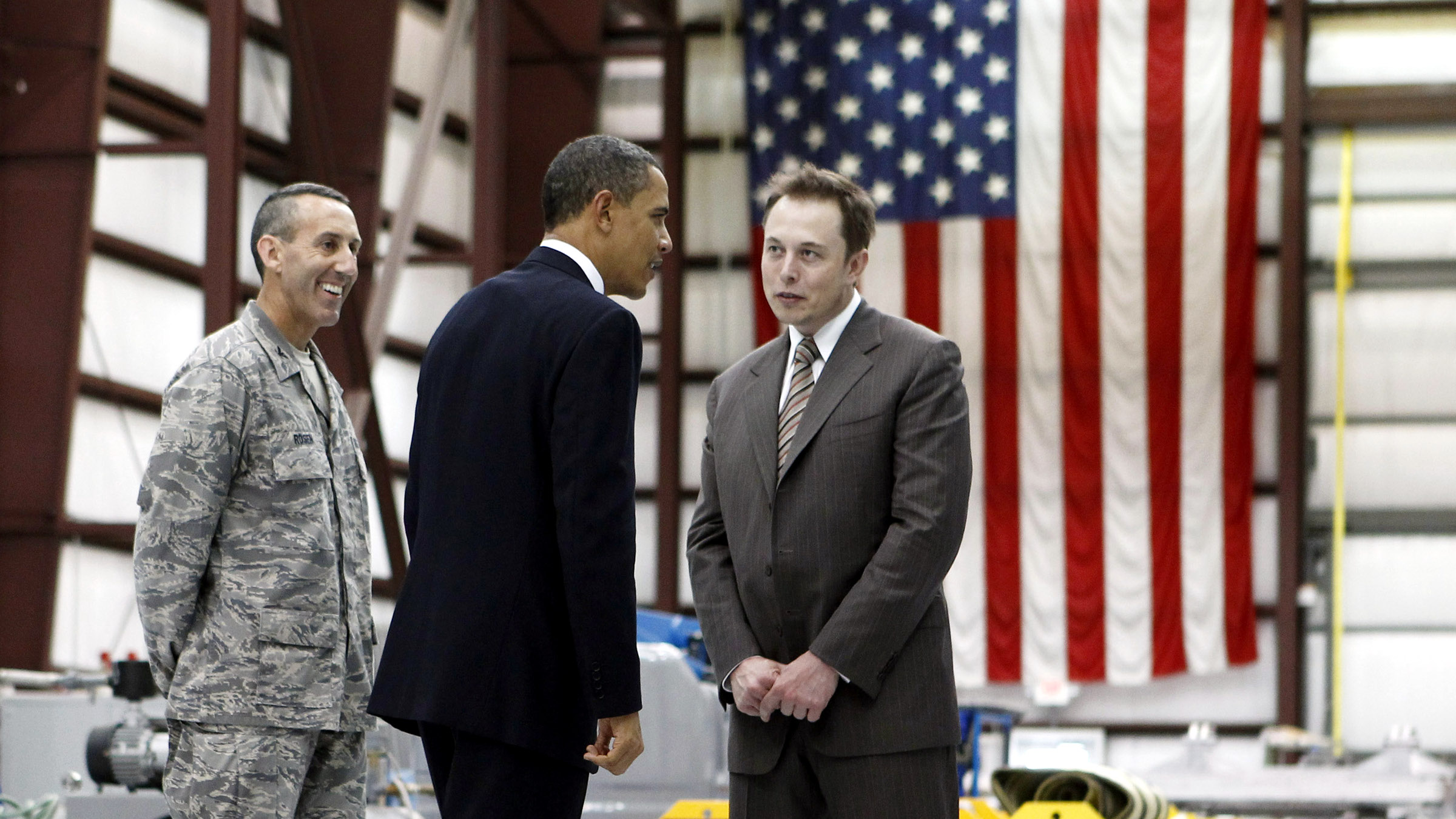U.S. President Barack Obama (C) and Head of SpaceX Elon Musk (R) tour Cape Canaveral Air Force Station in Cape Canaveral, Florida, April 15, 2010.