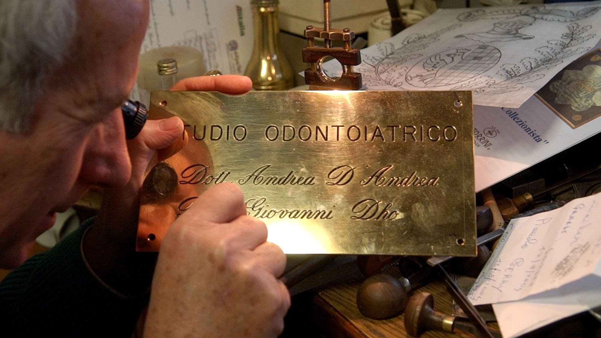 "Engraver Pietro Negri works on a hand-engraved name plate for a dentist's studio, in his shop, in Rome, Wednesday, Nov. 24, 2004. Yell for a doctor in an Italian cinema and you risk a stampede. Almost everybody here, it seems, is a ""dottore.'' or a ""professore'' or a ""maestro'' or some other bearer of an honorific. The universe of Italian titles expanded this month when an administrative court ruled that even those who pursue the new ``short'' university degree -- achieved in only three years, instead of the usual four to five years of study -- have the legal right to call themselves ""dottore.'' (AP Photo/Plinio Lepri)"