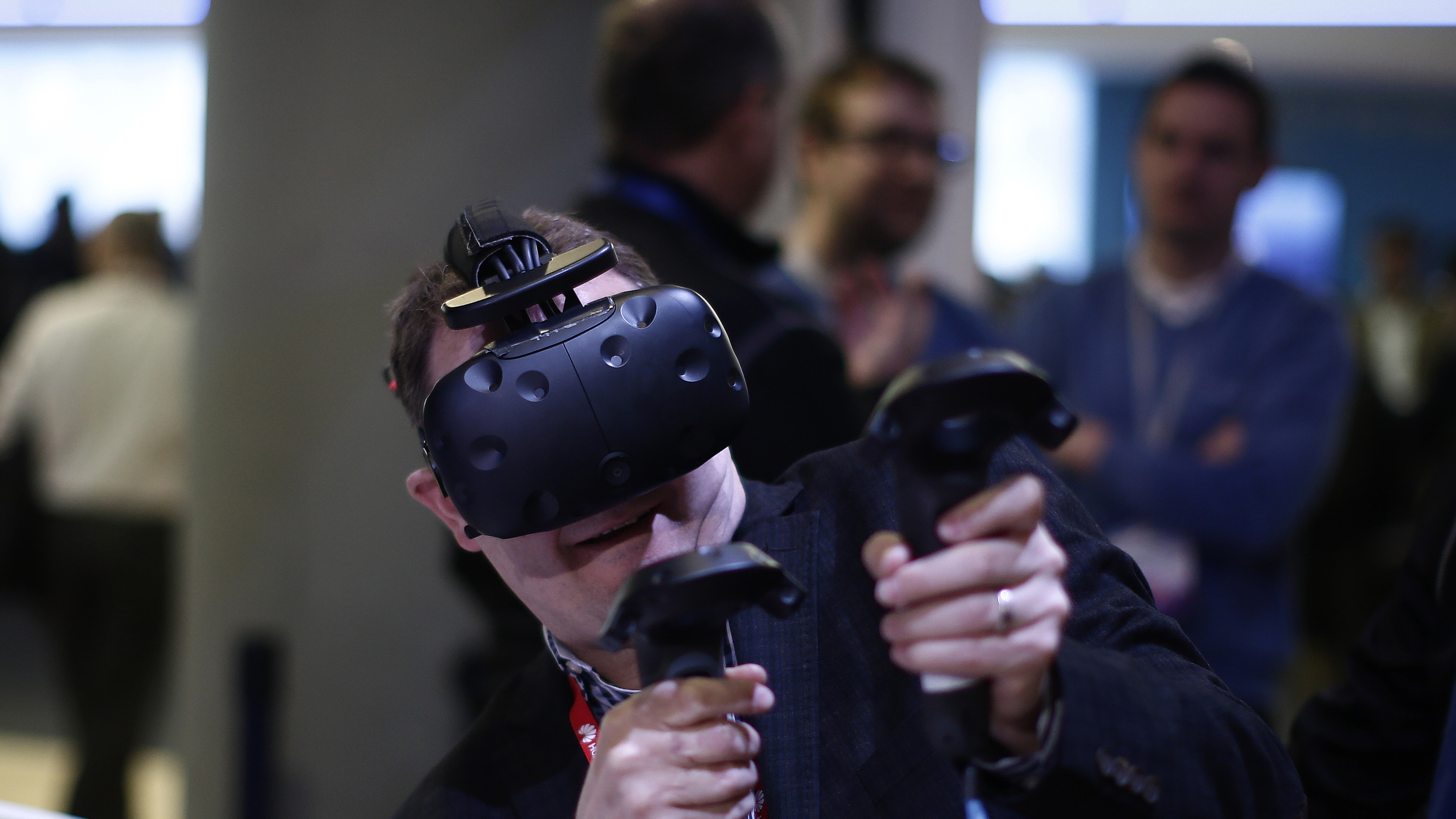 A visitor plays with a virtual reality glasses at the Mobile World Congress in Barcelona, Spain, Wednesday, March 1, 2017. Mobile World Congress, the world's leading mobile industry event, runs 27 February - 2 March in Barcelona, Spain. (AP Photo/Manu Fernandez)