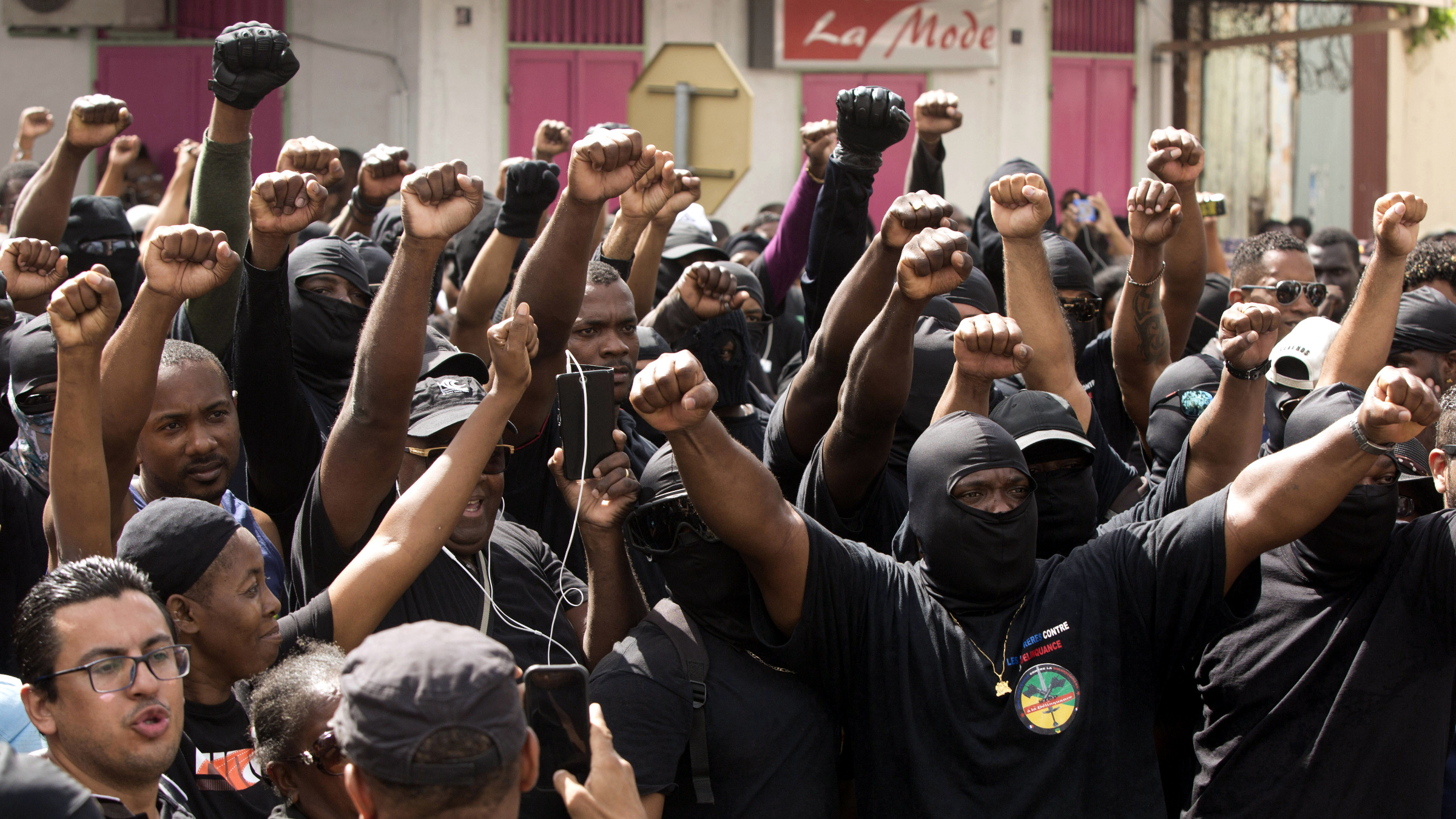 """FILE - In this Tuesday, March 28, 2017 file picture, masked members of the collective """"500 Brothers"""" take part in a march supporting a general strike in Cayenne, French Guiana. French government calls on protesters in French Guiana to lift the roadblocks after a 1 billion euro government plan to help the South American territory has been presented during Cabinet meeting."""