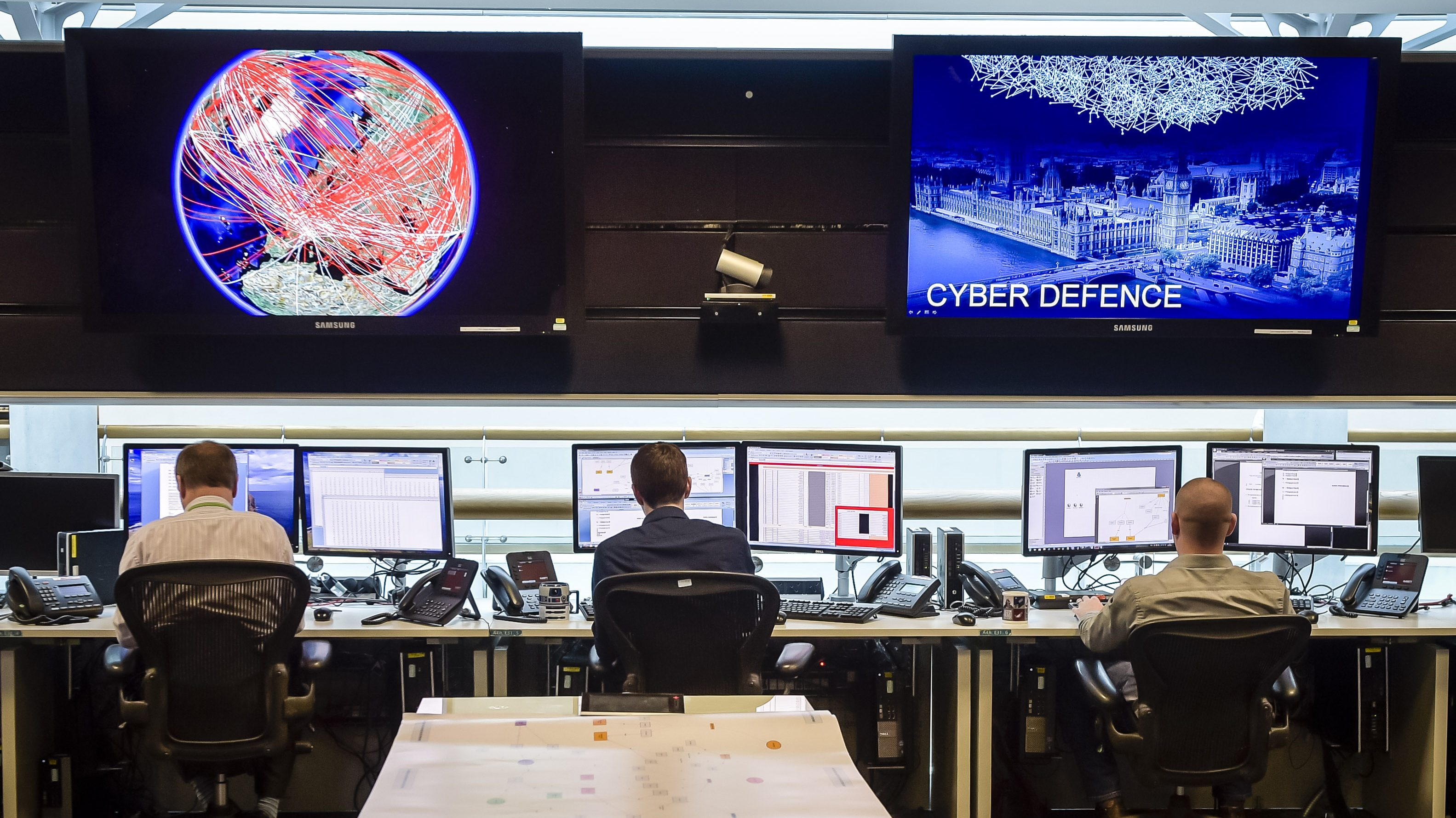 People sit at computers in the 24 hour Operations Room inside GCHQ, Cheltenham in Cheltenham