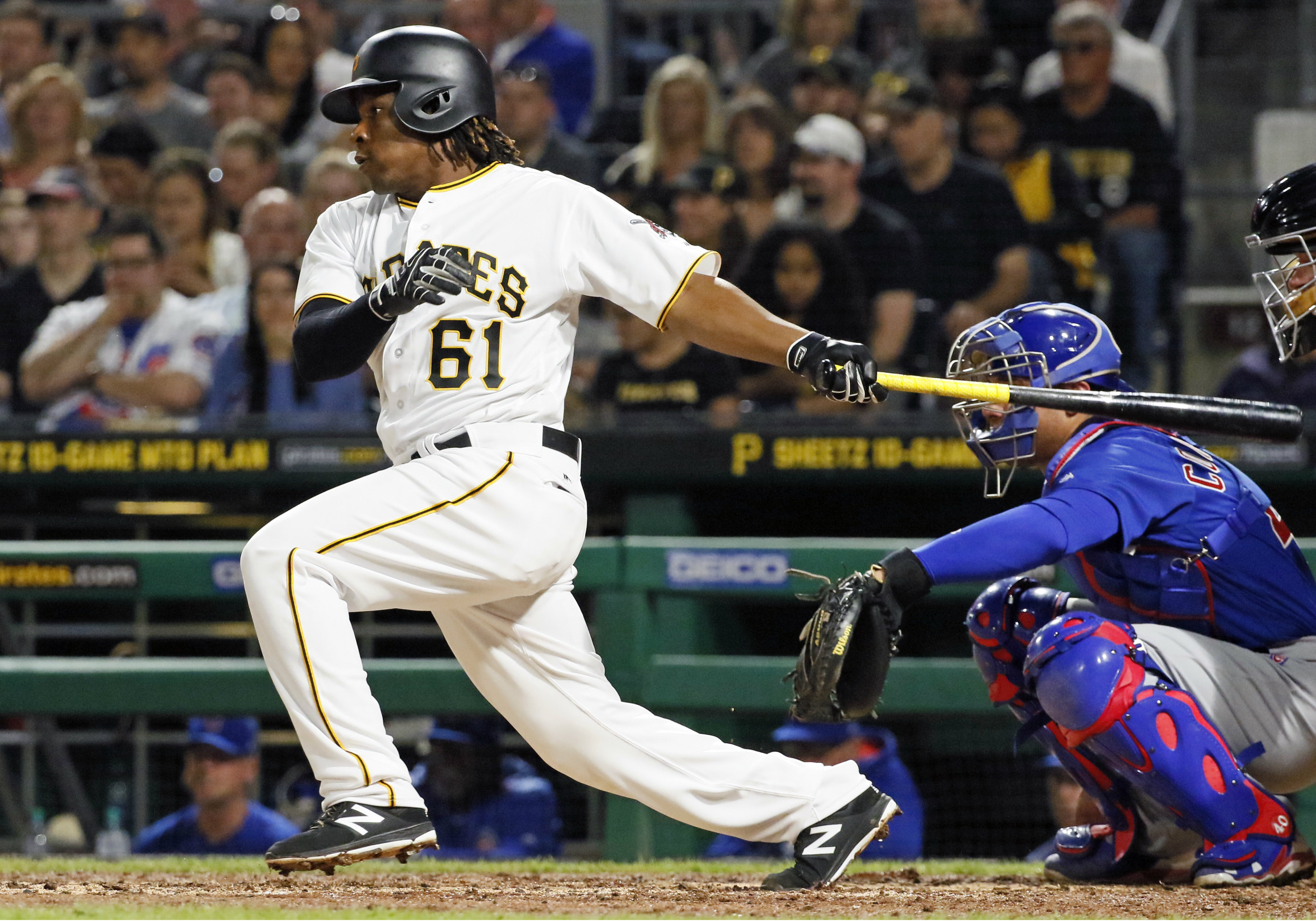 Pittsburgh Pirates' Gift Ngoepe, a native of South Africa, and the first baseball player from the continent of Africa to play in the Major Leagues, hits a single off Chicago Cubs starting pitcher Jon Lester in his first at-bat in the fourth inning of a baseball game in Pittsburgh, Wednesday, April 26, 2017.