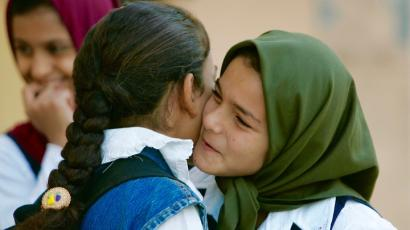Students greet on the first day of school in Baghdad.