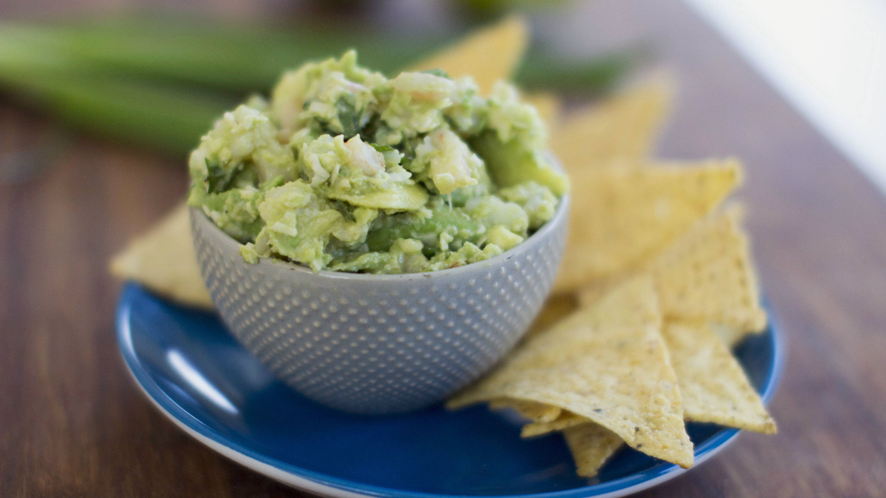This Dec. 15, 2014 photo shows shrimp scampi guacamole in Concord, N.H. There are multiple ways to serve up guacamole for the Super Bowl. (AP Photo/Matthew Mead)