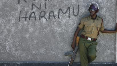 An officer of the General Service Unit (GSU) leans against the wall while patrolling near the Masjid Shuhadaa mosque, where slain Muslim cleric Sheikh Abubakar Shariff used to preach, in the Majengo area of the port city of Mombasa, Kenya, 04 April 2014. Hundreds of Muslims gathered outside the mosque after Friday prayers to protest against the killing of prominent Muslim cleric Abubakar Shariff, also known as Makaburi (meaning 'graveyard' in Swahili language), and clashed with riot police officers. The coastal city is on high alert following the killing of the radical Muslim cleric, whom the United States and the United Nations accuse of supporting Somalia's Islamist militants group al-Shabab. Shariff was gunned down 01 April as he walked out with another man from law courts where he had gone to find out whether his bail conditions had been reduced. Muslim leaders have warned the government that they will take it to the street unless the government reveals by 05 April who were responsible for the killing of the cleric.