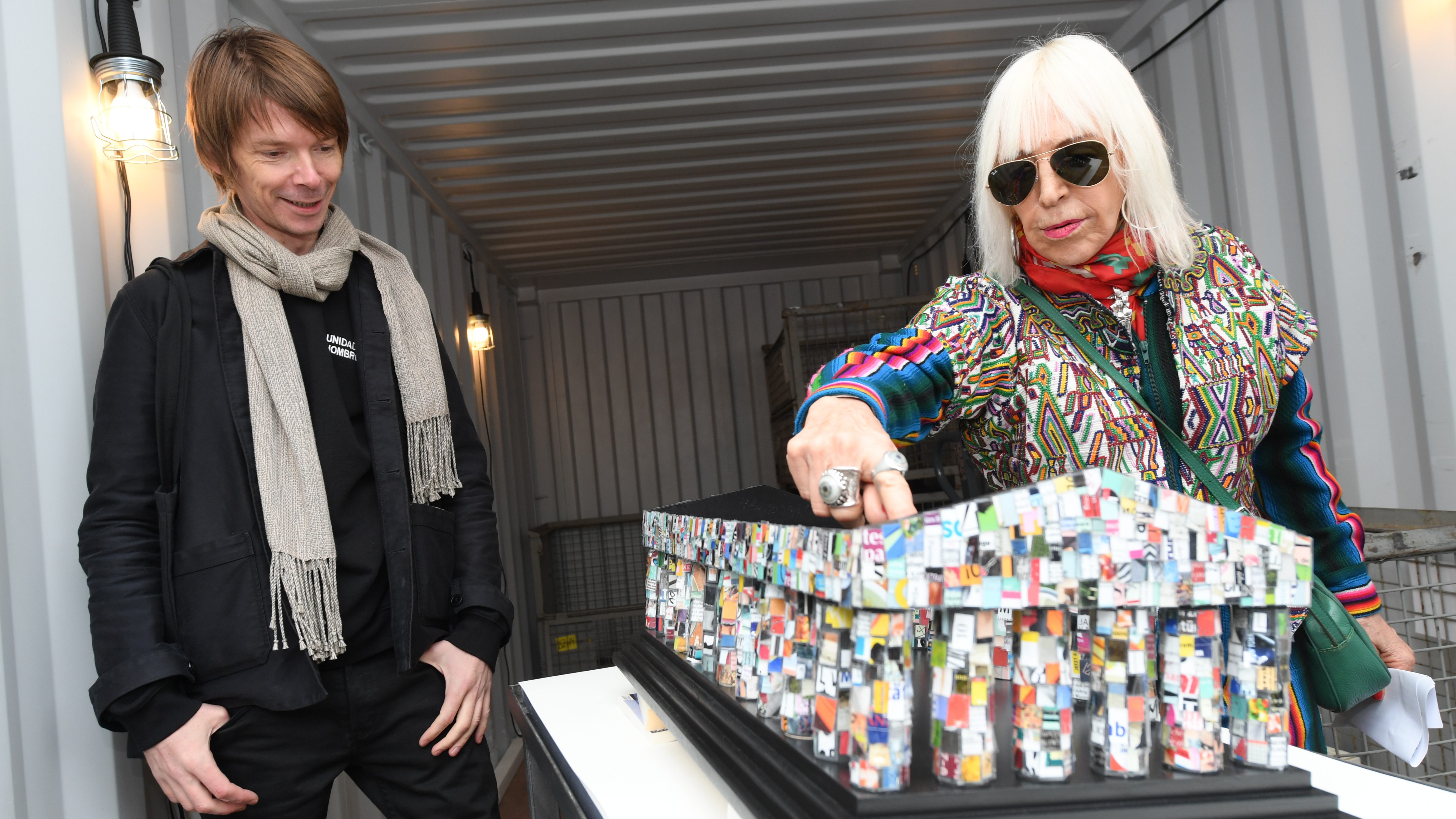 epa05594062 Argentinian artist Marta Minujin (R) and Poilsh art director of the documenta 14 fair, Adam Szymczyk stand in front of her installation 'The Parthenon of Books'at the Frankfurt Book Fair, in Frankfurt am Main, Germany, 20 October 2016. During the book fair, formerly forbidden and now republished books are gathered for an installation of Minujin, which will be presented at the documenta 14 art fair in Kassel, Germany on 10 June 2017. The book fair is the largest in the world and will run from 19 to 23 October.  EPA/ARNE DEDERT