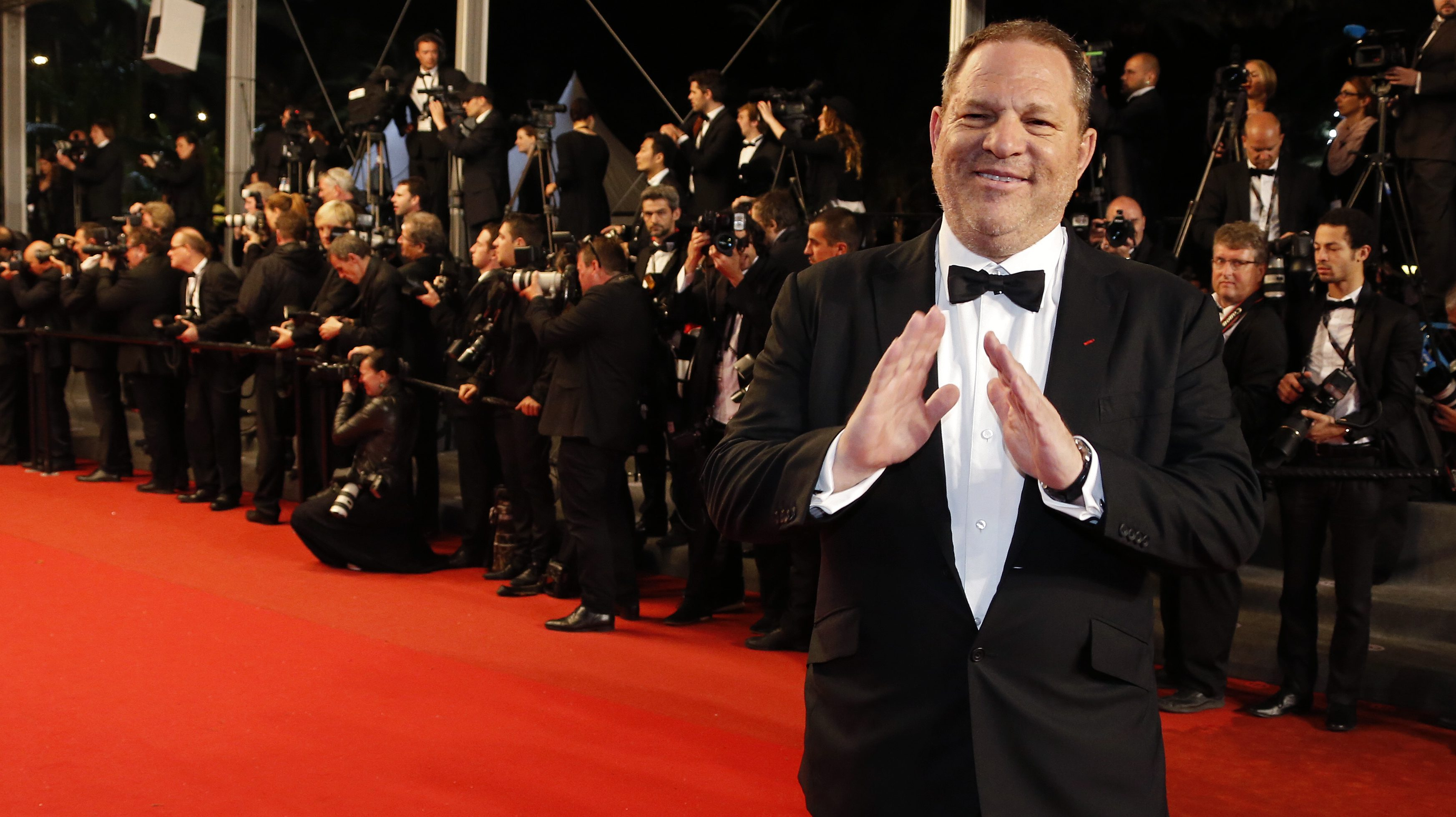 """Producer Harvey Weinstein poses on the red carpet as he arrives for the screening of the film """"Only God Forgives"""" in competition during the 66th Cannes Film Festival in Cannes May 22, 2013.               REUTERS/Eric Gaillard (FRANCE  - Tags: ENTERTAINMENT)   - RTXZX0H"""