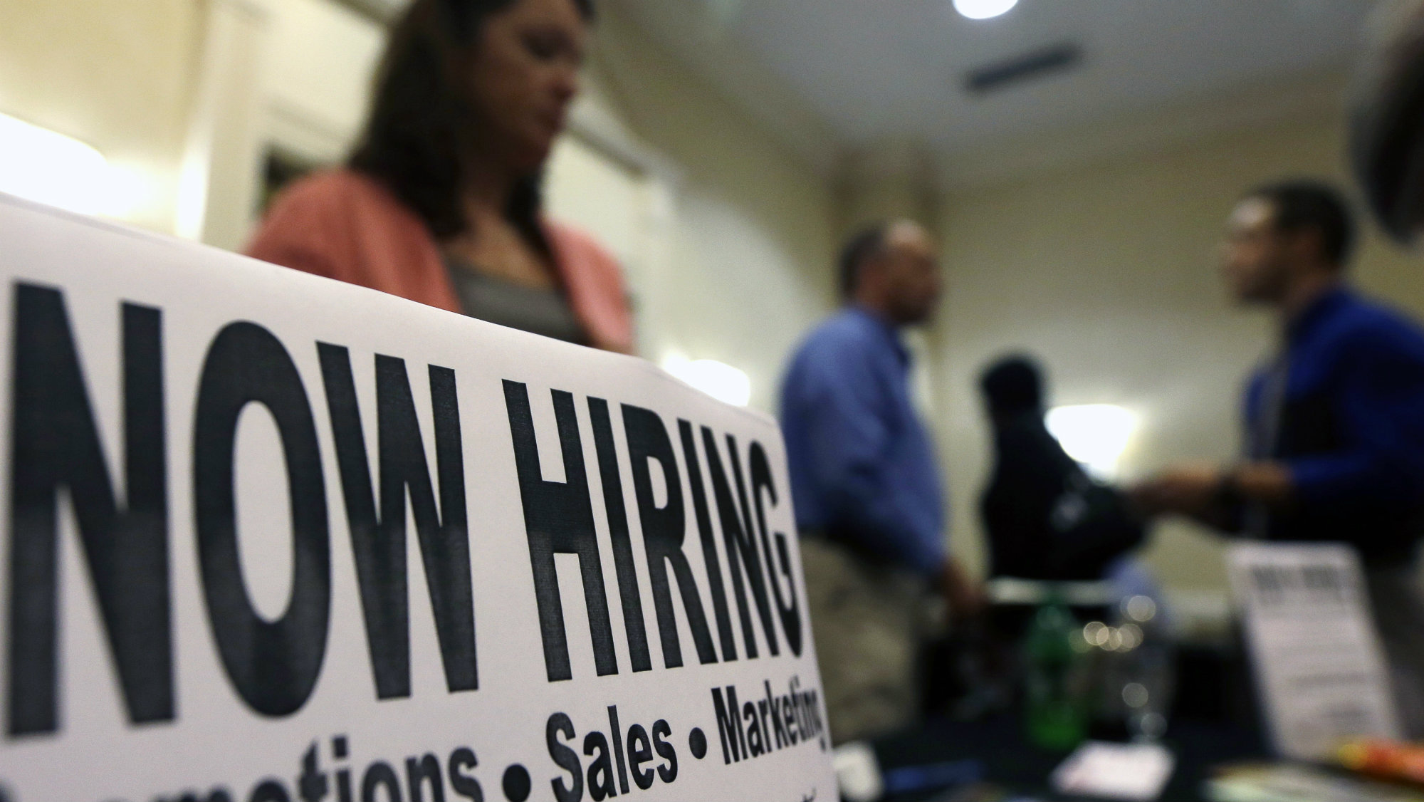 In this Thursday, Oct. 25, 2012, file photo, a sign attracts job-seekers during a job fair at the Marriott Hotel in Colonie, N.Y.