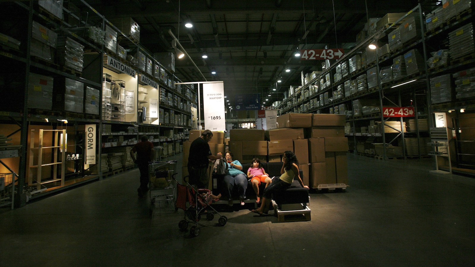 Shoppers rest in a branch of the Swedish retail store IKEA in the Israeli city of Netanya, north of Tel Aviv August 24, 2009. According to Israeli media reports, thousands of Israelis have signed a petition to boycott the retailer amid a row with Sweden over a Swedish newspaper which repeated Palestinian accusations dating from the early 1990s that Israeli troops took organs from men who died in custody. A spokesperson for IKEA said on Monday that they are a commercial non-political organization that has and will continue to have an excellent relationship with Israeli consumers.  REUTERS/Ronen Zvulun (ISRAEL POLITICS BUSINESS) - RTR272JI