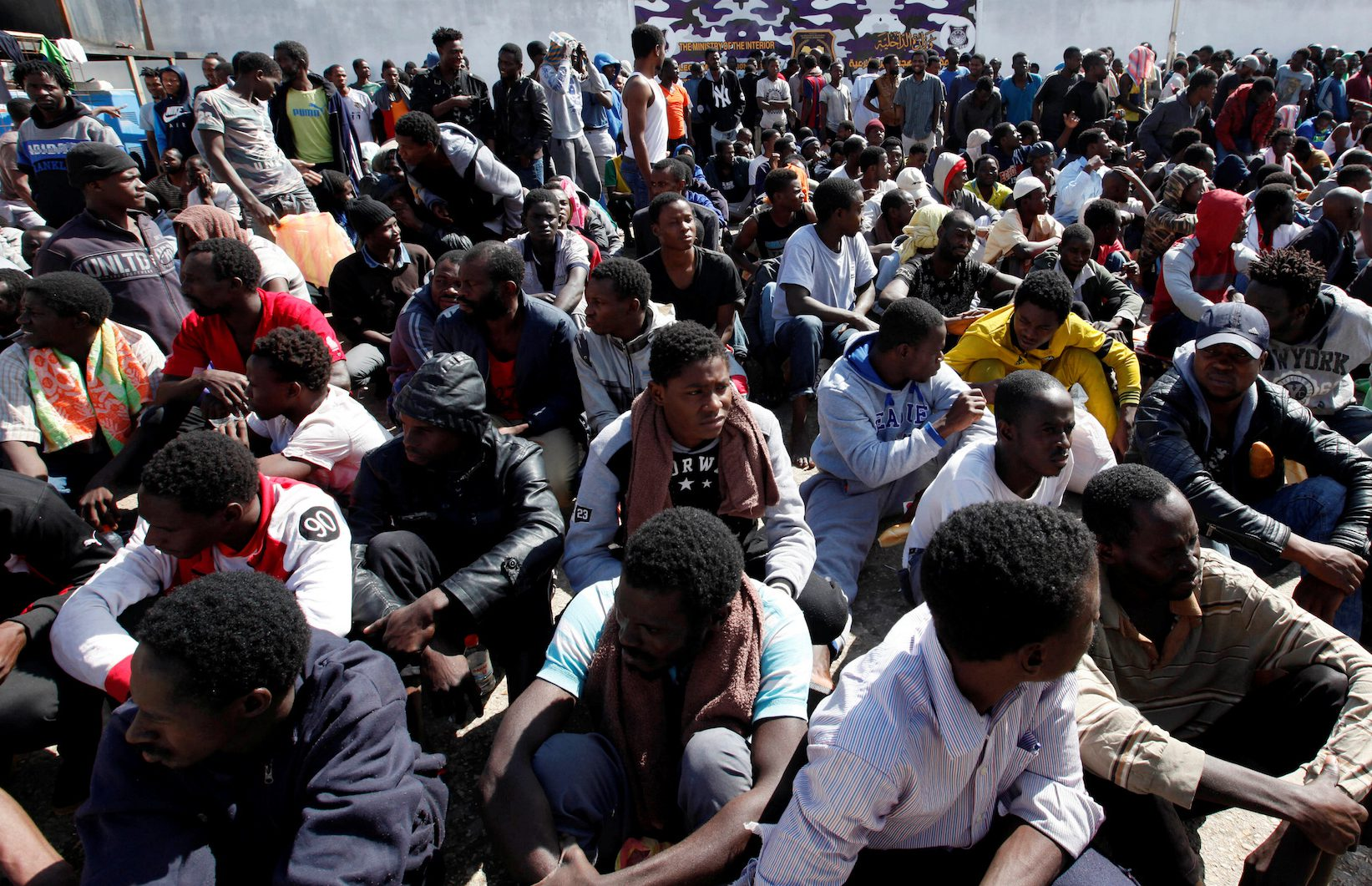 Illegal African migrants sit during a visit by U.N. Special Representative and Head of the United Nations Support Mission in Libya Martin Kobler and International Organization for Migration Director General William Lacy Swing at a detention camp in Tripoli, Libya, March 22, 2017.