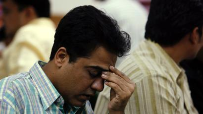A broker reacts while trading at a stock brokerage firm in Mumbai