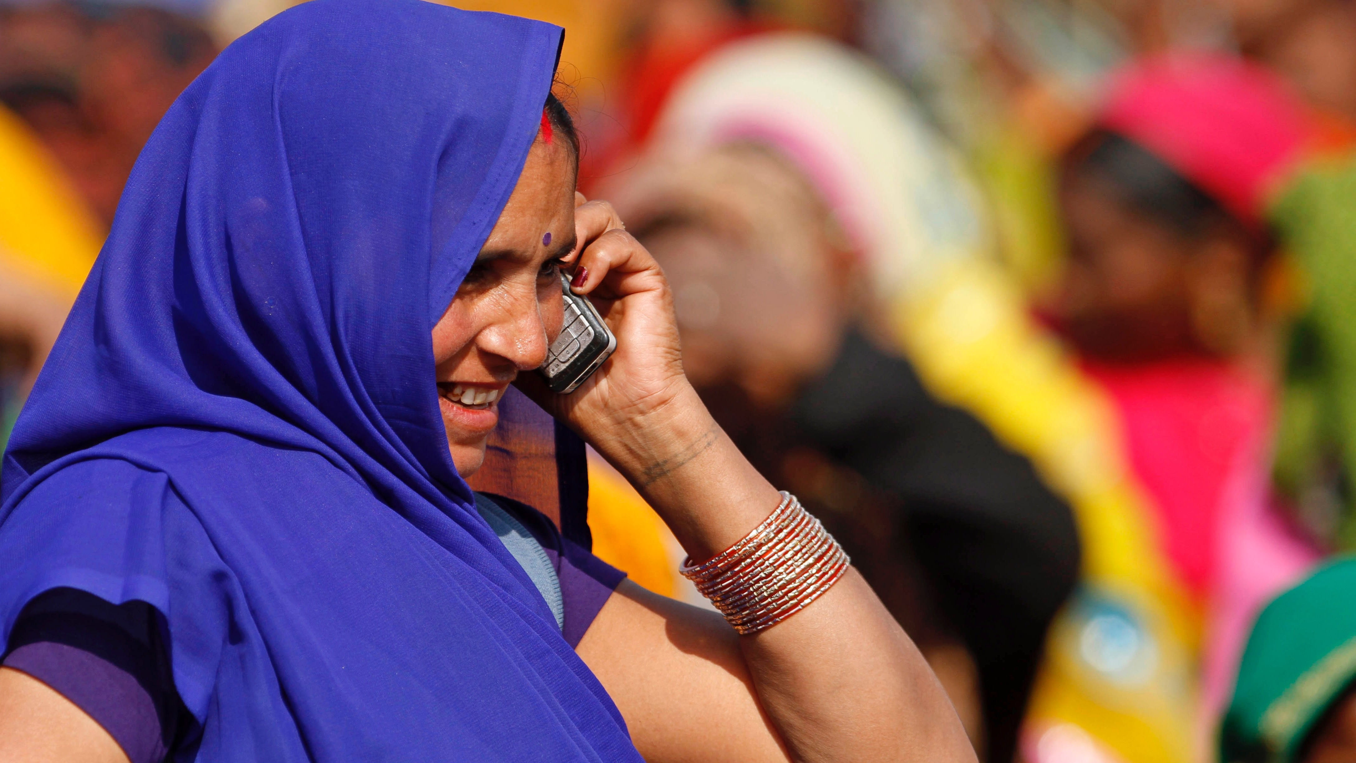 Rural Indian woman on the phone