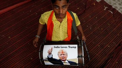 A member of Hindu Sena, a right-wing Hindu group, plays a drum with U.S. Republican presidential nominee Donald Trumpís picture on it as they symbolically celebrate his victory in the upcoming U.S. elections, in New Delhi