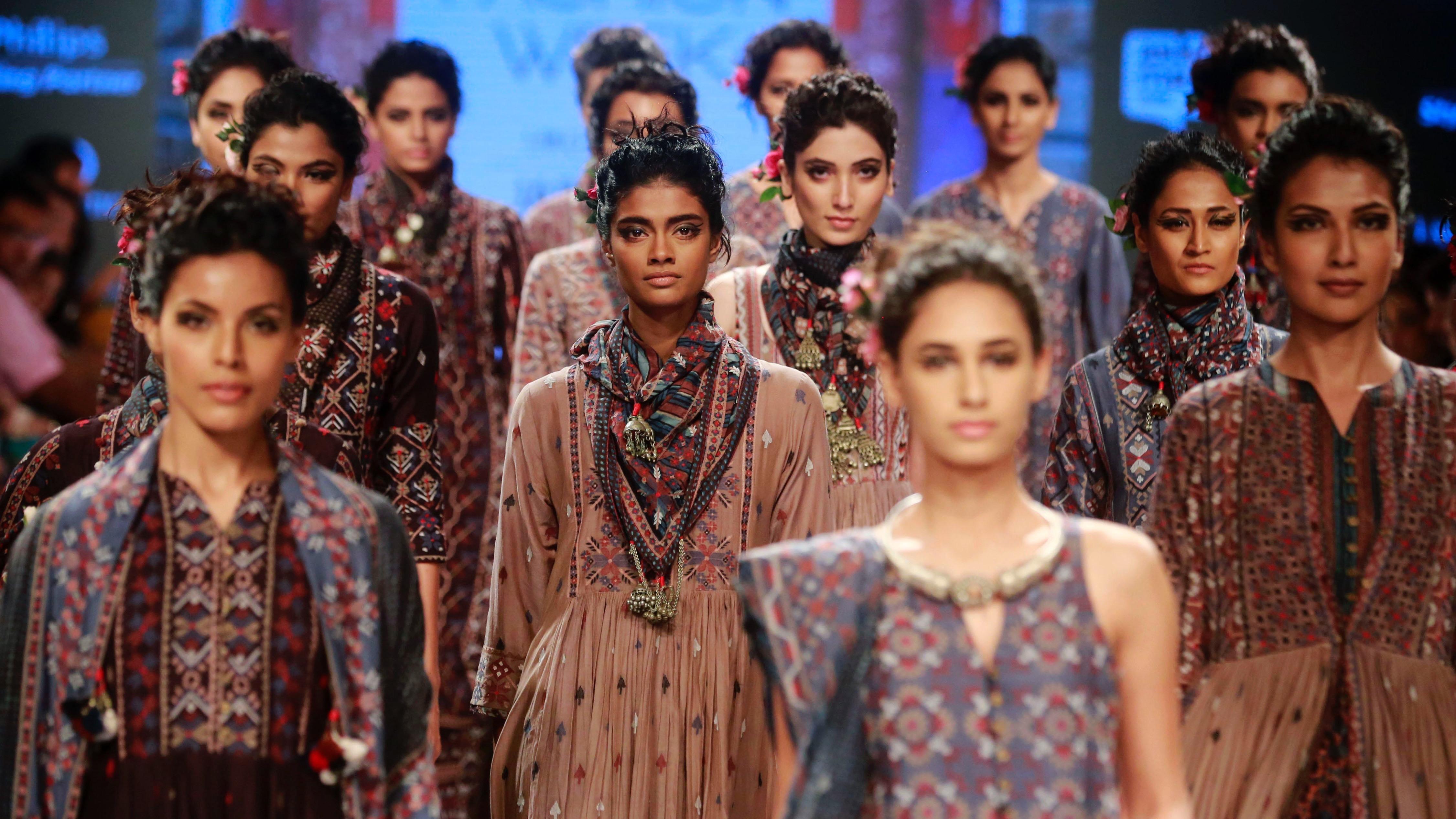 Indian models display creations by designer Rahul and Shikha during the Lakme Fashion Week in Mumbai, India, Thursday, Aug. 27, 2015. (AP Photo/Rafiq Maqbool)