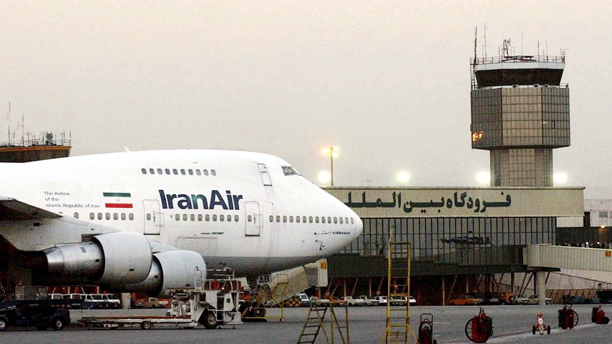 "FILE - In this June 2003 file photo, a Boeing 747 of Iran's national airline is seen at Mehrabad International Airport in Tehran. Boeing Co. has confirmed signing an agreement with Iran Air ""expressing the airline's intent"" to buy its aircraft. In a statement Tuesday to The Associated Press, Boeing said it signed the agreement ""under authorizations from the U.S. government following a determination that Iran had met its obligations under the nuclear accord reached last summer."""