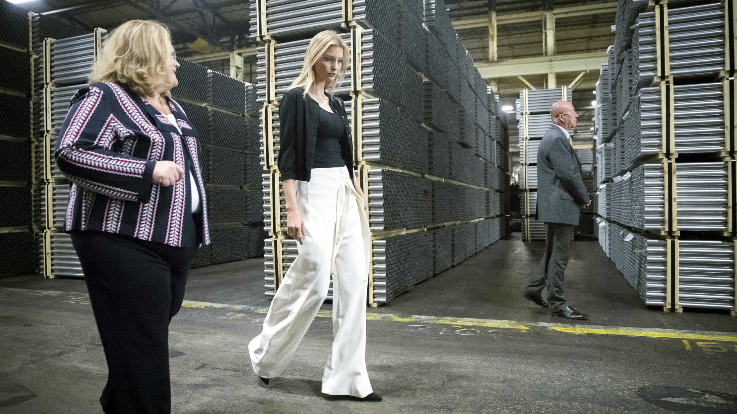 Ivanka Trump, daughter of Republican presidential candidate Donald Trump, tours Middletown Tube Works, a welded steel tube supplier, alongside owner Angela Phillips, left, Thursday, Oct. 6, 2016, in Middletown, Ohio.