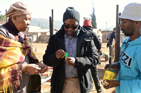 Director Mandla Dube, center, on the set of 'Kalushi' with Dr. Gcina Mhlope, who portrays Mahlangu's mother.