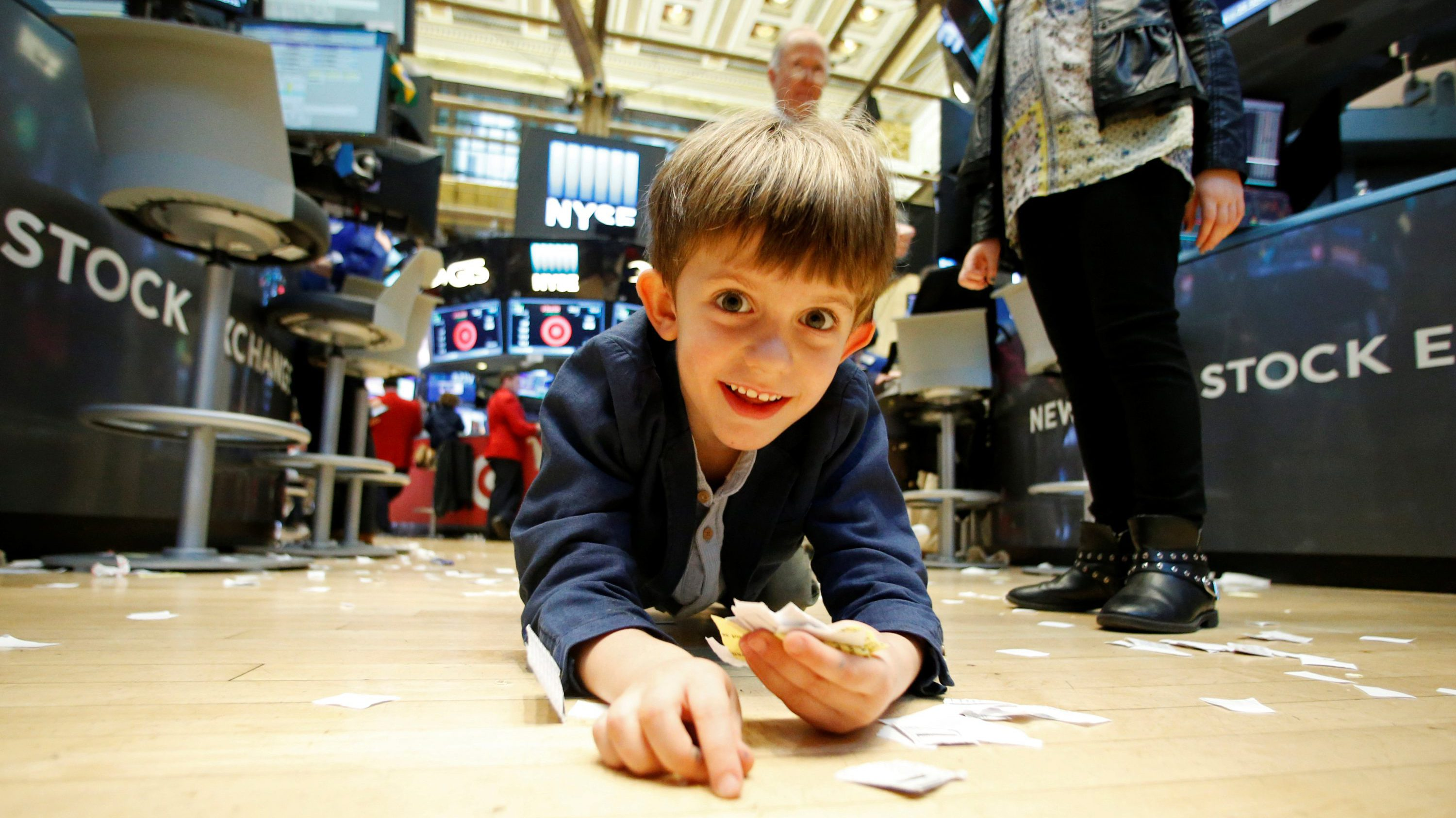 A boy plays during Kids' Day on the floor of the New York Stock Exchange (NYSE) in New York City, U.S., November 25, 2016.