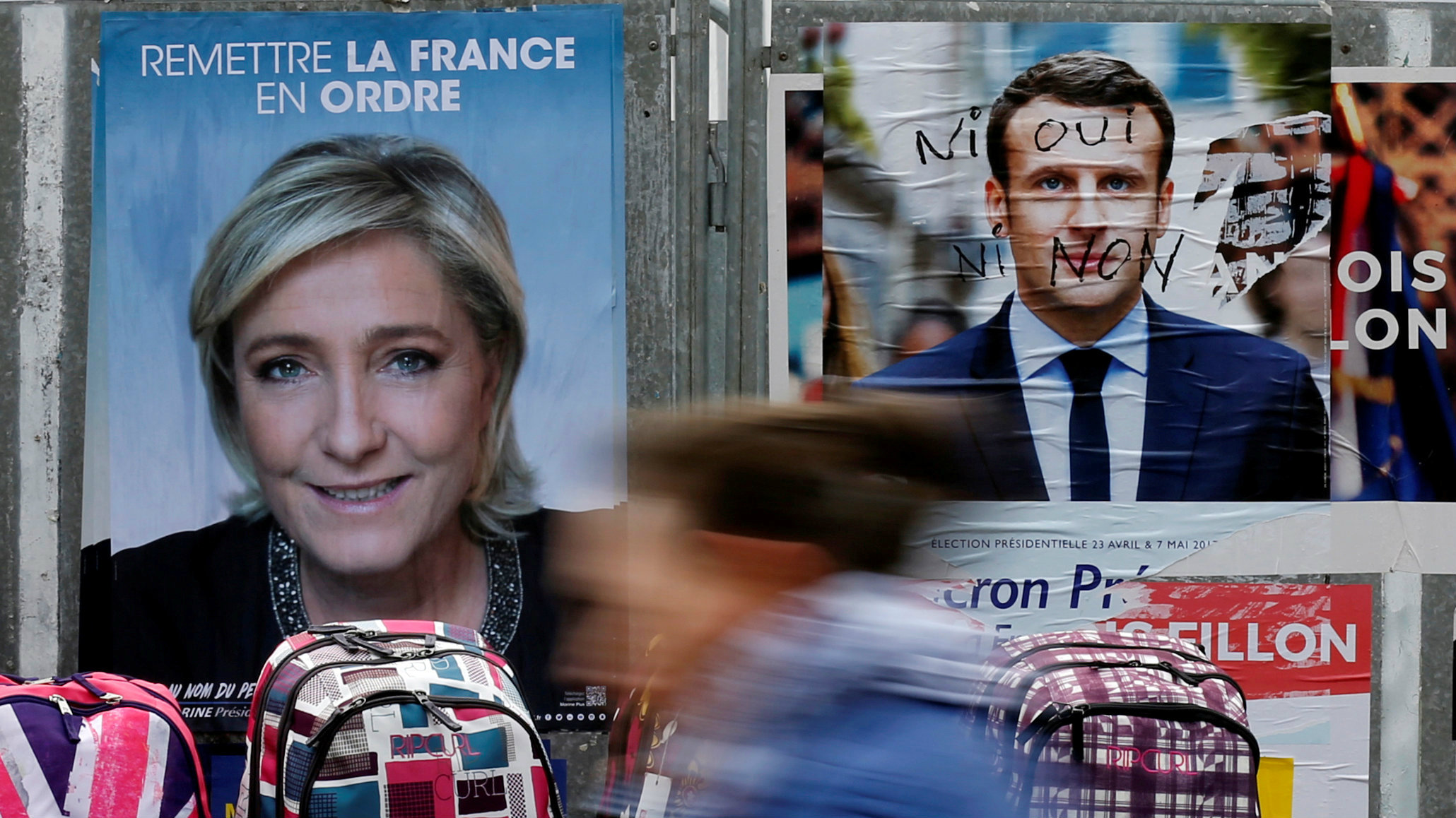 le pen and macron posters