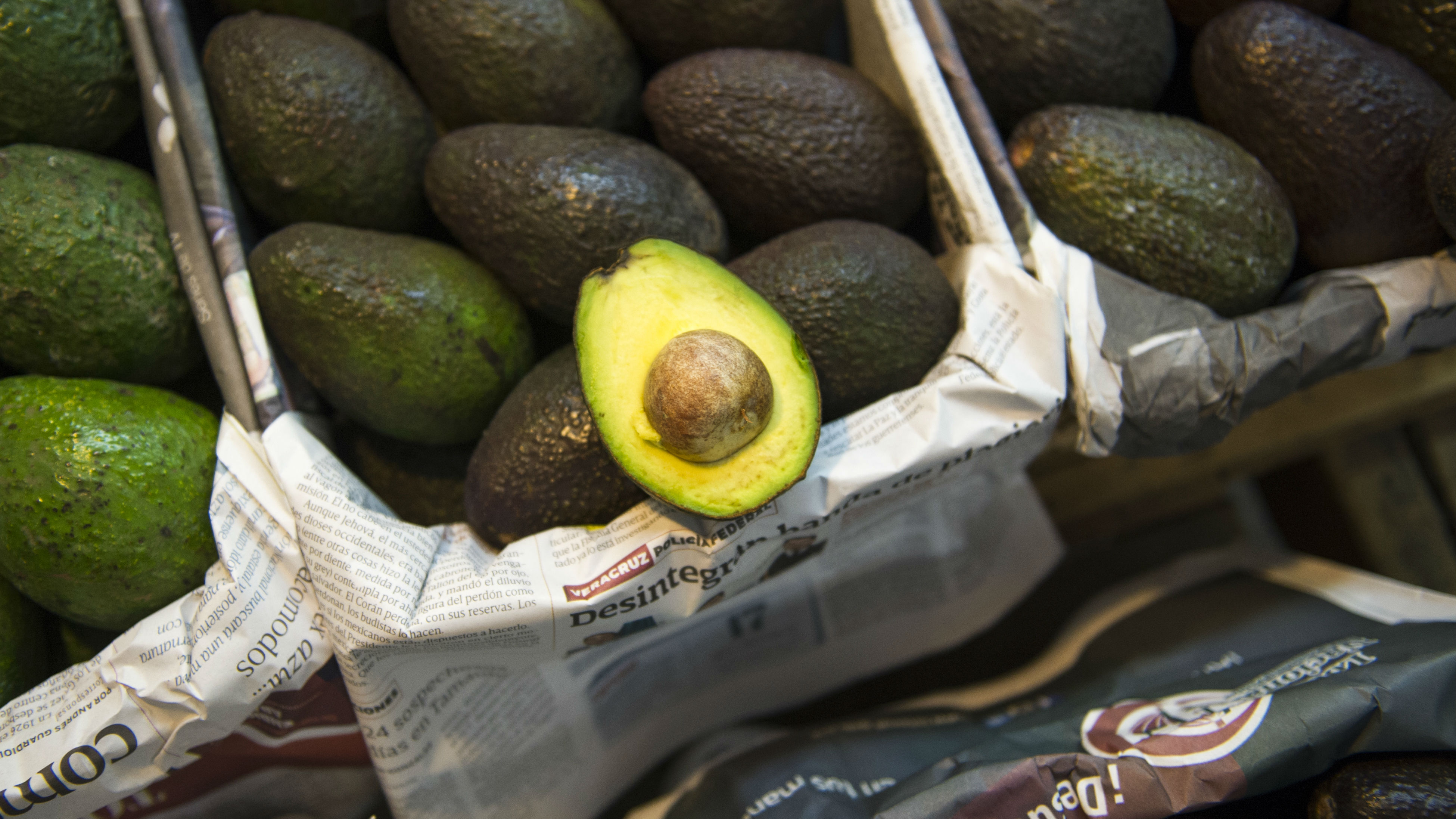 Avocados are displayed for sale in a large market in Mexico City, Tuesday, Aug. 9, 2016. Avocado trees flourish at about the same altitude and climate as the pine and fir forests of Michoacan, the state that produces most of Mexico's avocados. That has led farmers to fight a game of cat-and-mouse with authorities, thinning the forests and planting young avocado trees under the canopy.