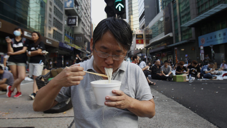 A man eating noodles