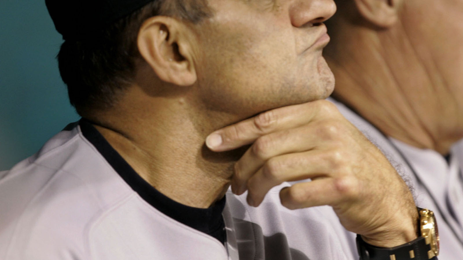 New York Yankees manager Joe Torre, left, rubs his chin while pitching coach Mel Stottlemyre yawns during the third inning of their game against the Tampa Bay Devil Rays Thursday night May 5, 2005, in St. Petersburg, Fla.  (AP Photo/Chris O'Meara)
