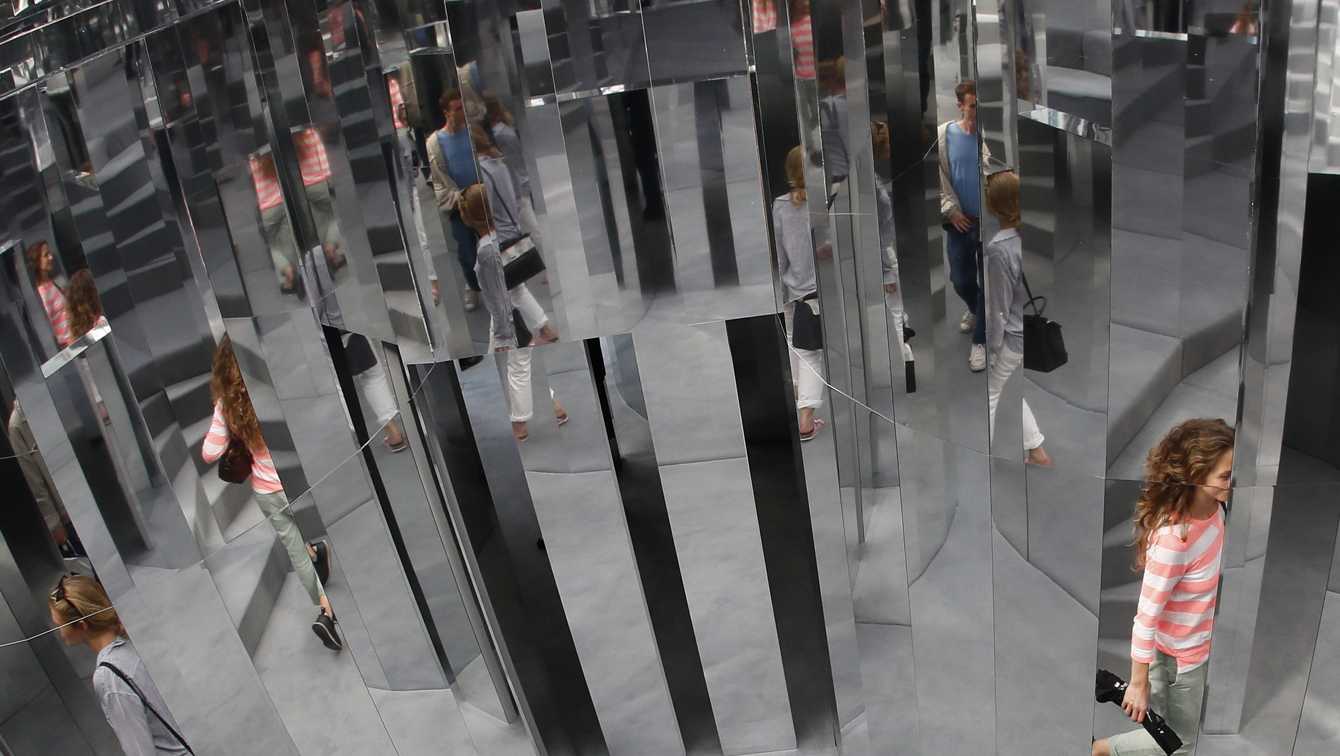 Visitors are reflected in the installation Mirror Maze by artist Es Devlin, at the Copeland Park in Peckham, south London, Britain September 21, 2016.