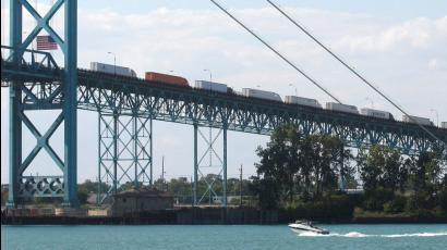 Commercial trucks line up on the Ambassador bridge crossing over to Detroit, Michigan from Windsor, Ontario