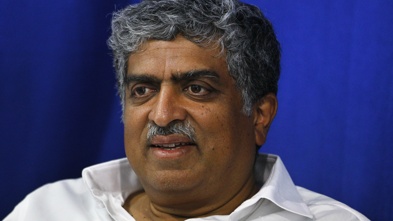 India's ruling Congress party candidate and former Chairman of Unique Identification Authority of India Nandan Nilekani attends a function at an old age home on the last day of election campaigning of his constituency in Bangalore, India, Tuesday, April 15, 2014. Nilekani is the richest candidate so far in the elections with his declared assets worth INR 77 billion (USD$ 1,277,032,465). The multiphase voting across the country runs until May 12, with results for the 543-seat lower house of parliament announced May 16.