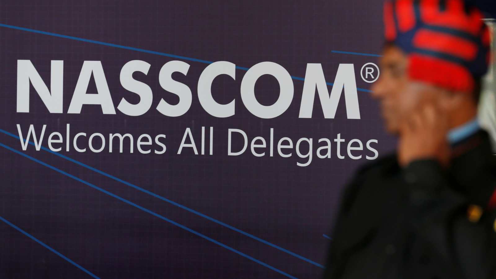 A security guard stands at the venue of National Association of Software and Services Companies (NASSCOM) India Leadership Forum in Mumbai, India February 16, 2017.