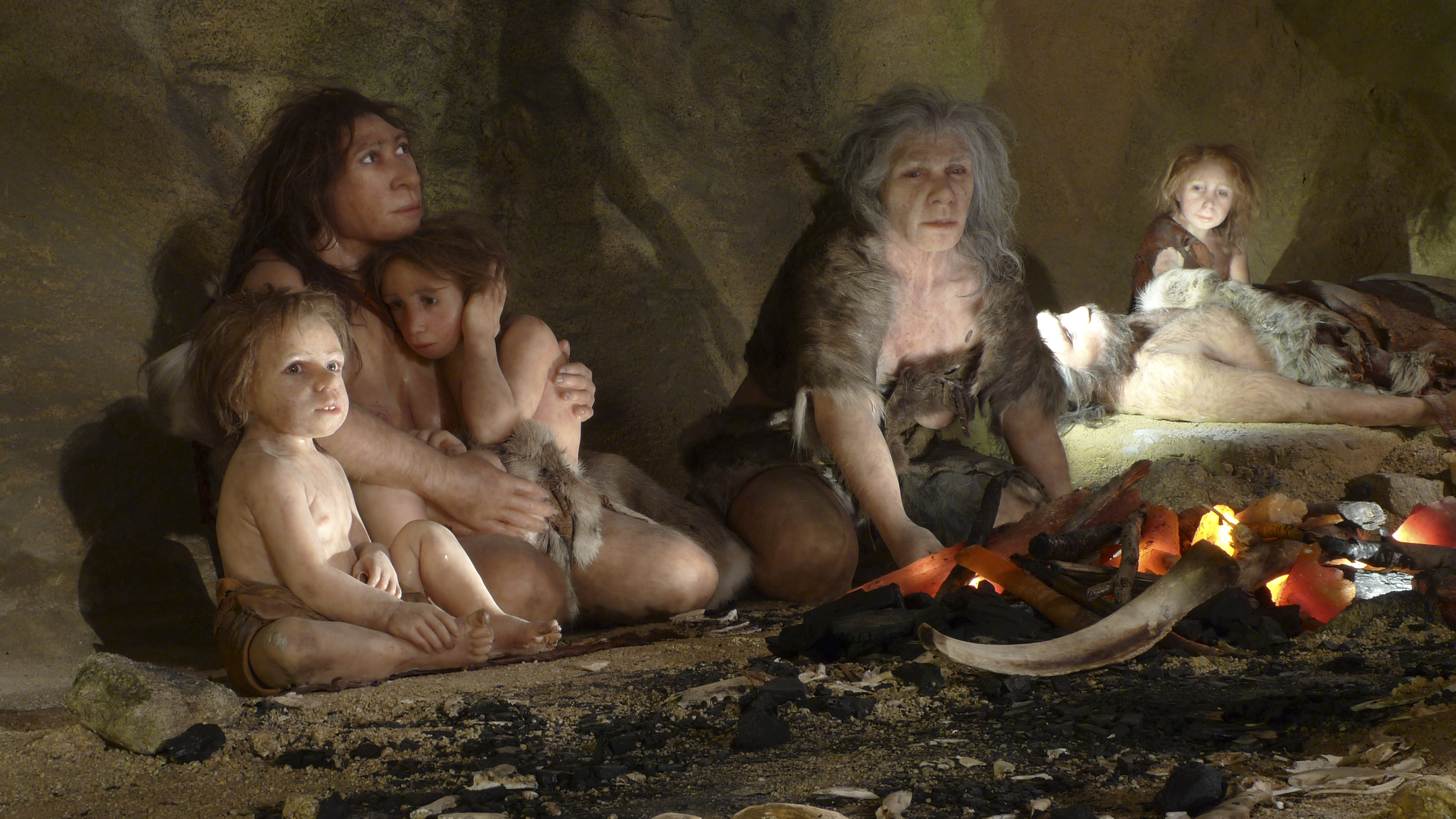 An artist's depiction of a Neanderthal family.