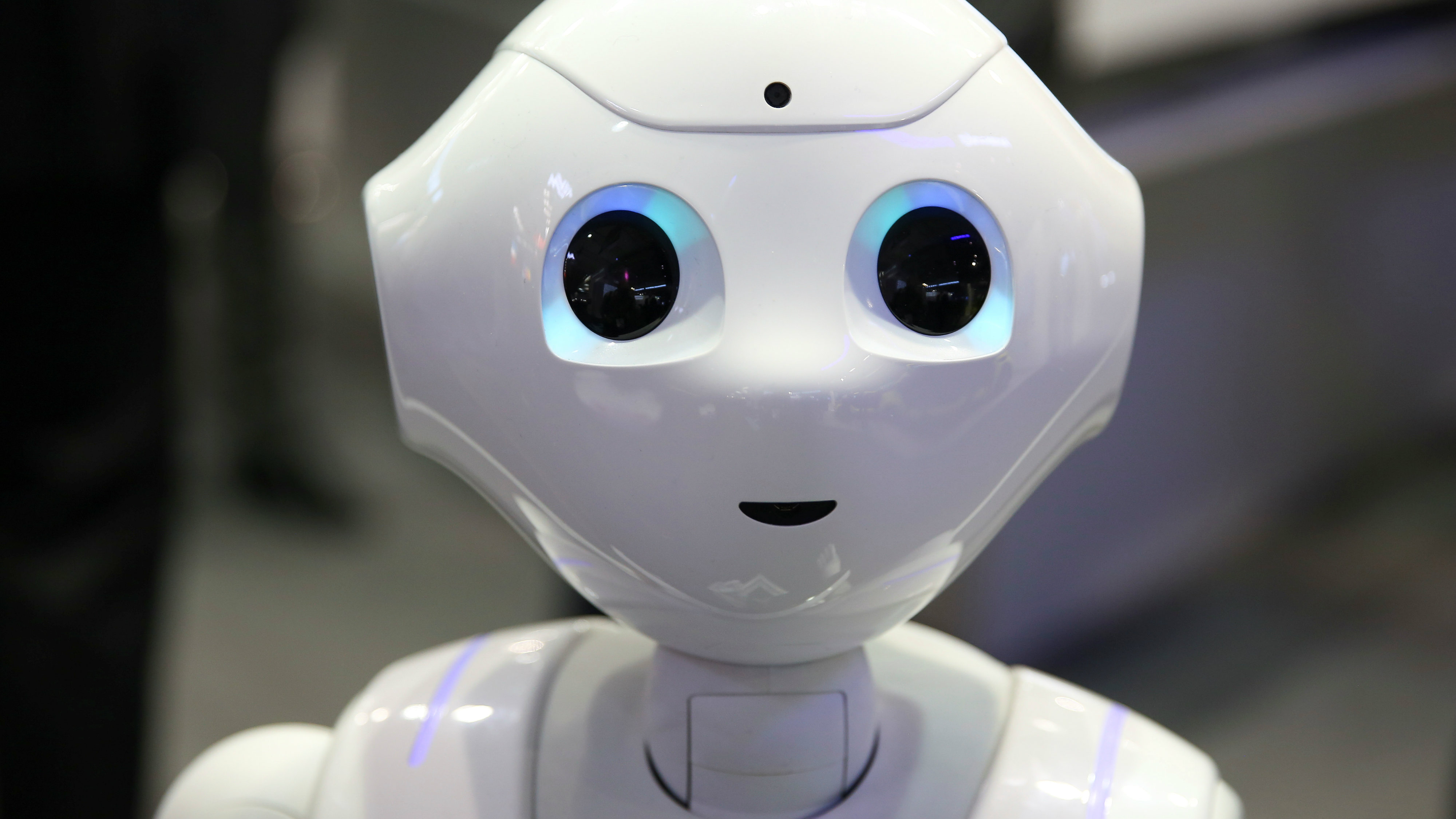 A robot speaks to attendees at the Oberthur Technologies stand at the Mobile World Congress in Barcelona, Spain March 1, 2017. REUTERS/Paul Hanna