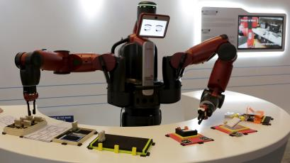A Baxter robot of Rethink Robotics picks up a business card as it performs during display at the World Economic Forum, in China's port city Dalian