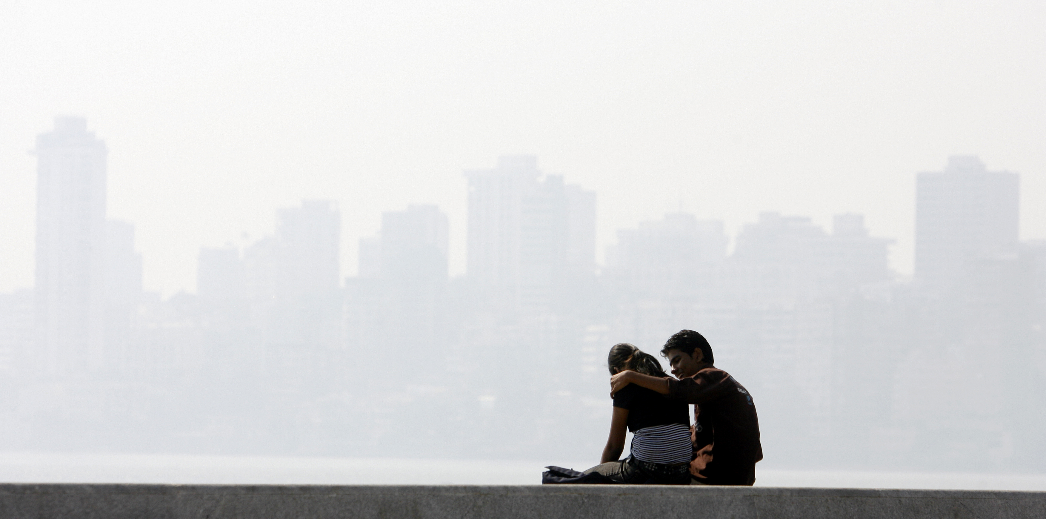 A couple sit at a waterfront on Valentine's Day in Mumbai February 14, 2008.