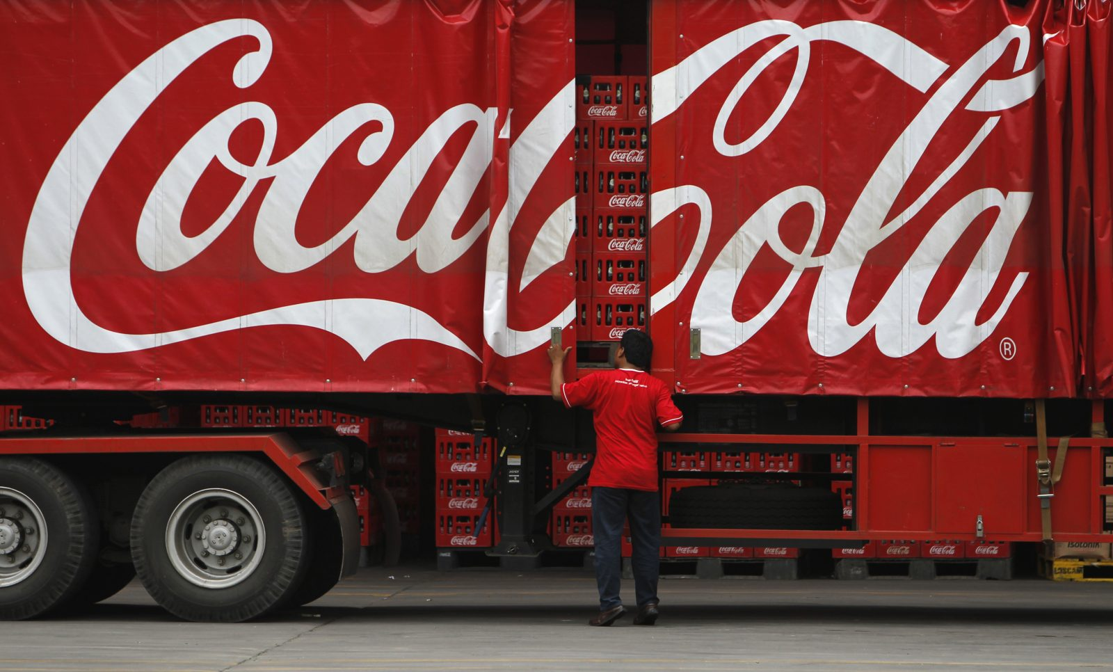 A worker checks his truck at PT Coca-Cola Amatil Indonesia's factory in Cibitung, Indonesia's West Java province, February 24, 2011. The Australian-based bottler and distributor for Coca Cola across Oceania had invested AUD$100 million ($101 million) in Indonesia over three years, doubling the company's investment in the country, Business Service Director Bruce Waterfield said during a media tour at the factory on Thursday.