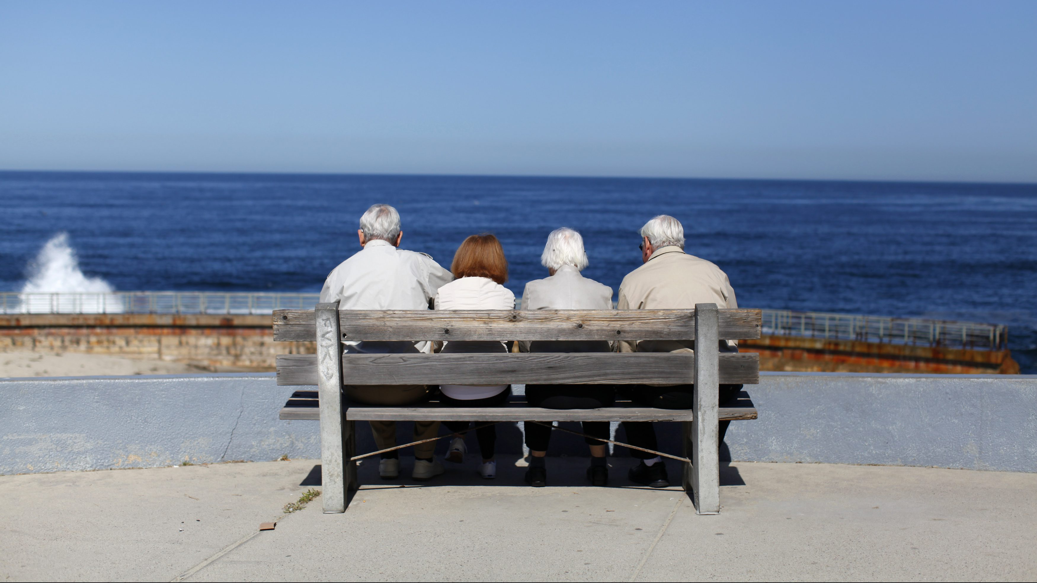 A pair of elderly couples view the ocean and waves along the beach in La Jolla, California March 8, 2012.  REUTERS/Mike Blake   (UNITED STATES - Tags: ENVIRONMENT SOCIETY TPX IMAGES OF THE DAY) - RTR2Z1YY