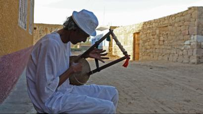 A man plays music on a traditional musical instrument in the Nubian village of Adindan near Aswan, south of Egypt, September 30, 2015. For half a century, Egypt's Nubians have patiently lobbied the government in Cairo for a return to their homelands on the banks of the Nile, desperate to reclaim territory their ancestors first cultivated 3,000 years ago. Yet all their efforts to gain political influence have brought next to nothing. In Egypt's incoming parliament, which will be finalised after a second round of voting on Sunday, the Nubians will hold just one of 568 elected seats. Picture taken September 30, 2015.