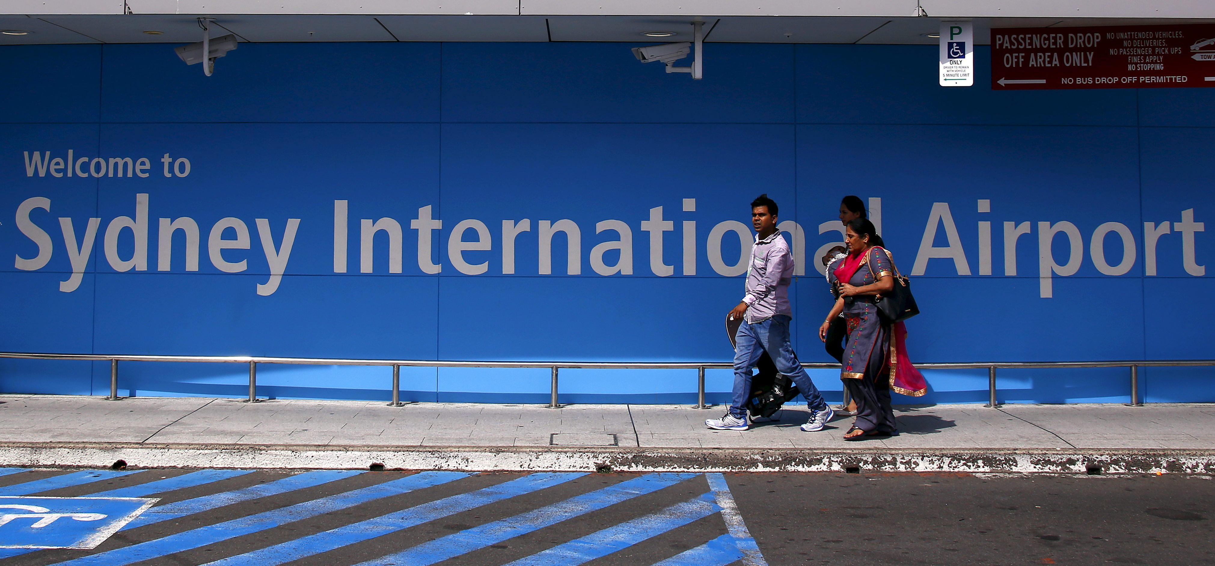 Passengers walk towards the departures area at Sydney International Airport, Australia, March 23, 2016.