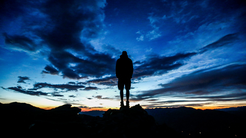 A man stands during sunrise on Kreuzjoch mountain in the Zillertal Alps in Schwendau, Austria July 11 2016.