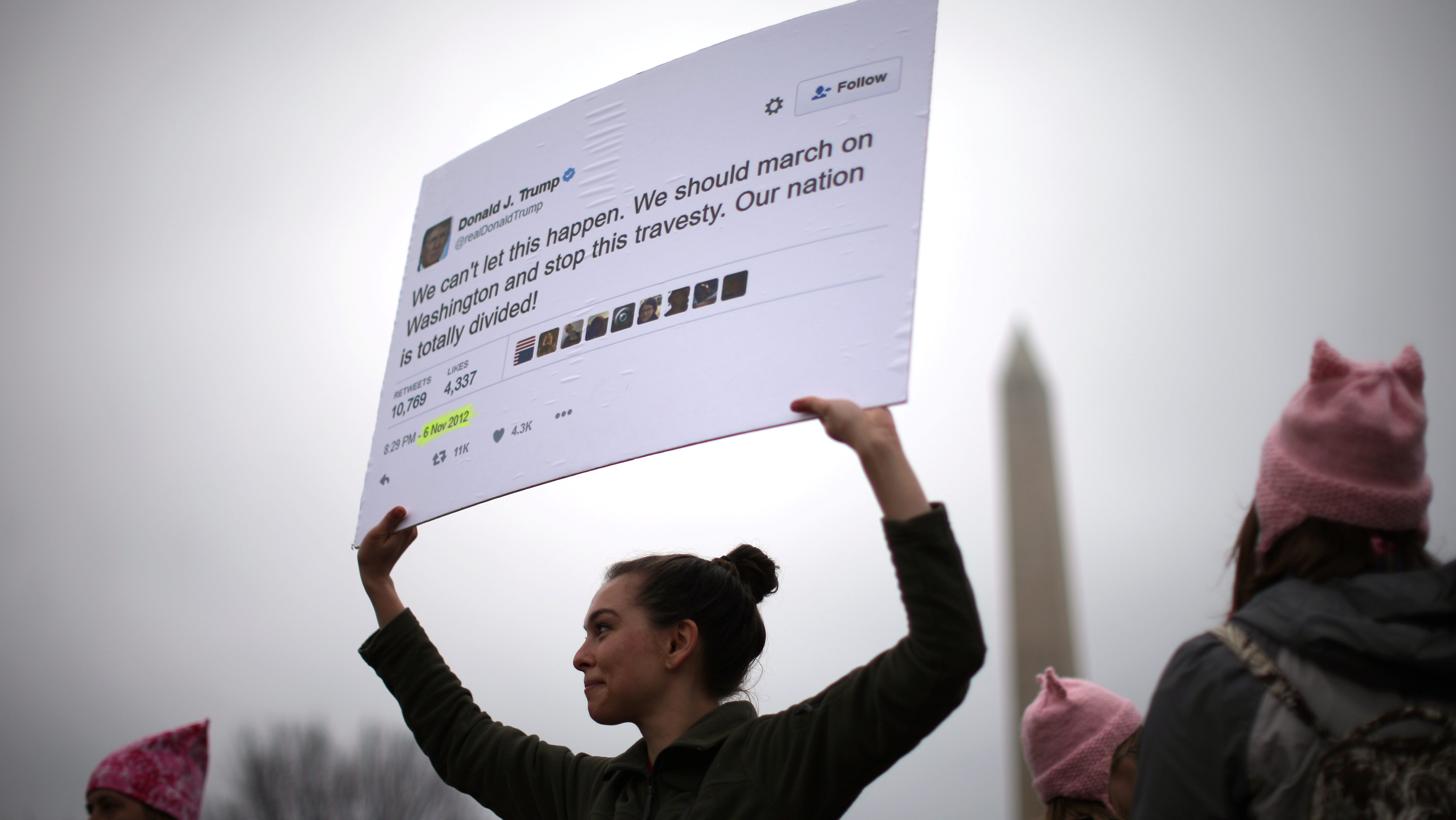 Marianne Nepsund, 29, from New York, holds a sign displaying one of U.S. President Donald Trump's tweets as she participates in the Women's March on Washington, following the inauguration of President Trump, in Washington, D.C., U.S., January 21, 2017.