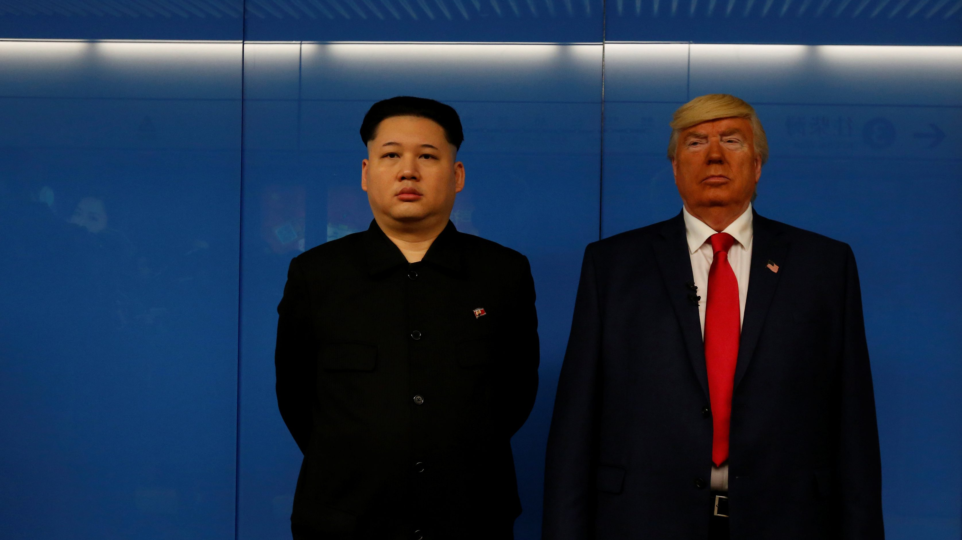 Dennis Alan of Chicago, 66, who is impersonating U.S. President Donald Trump, and Howard, 37, an Australian-Chinese who is impersonating North Korean leader Kim Jong-un, wait for a subway train in Hong Kong, China January 25, 2017.  REUTERS/Bobby Yip - RTSX8SP