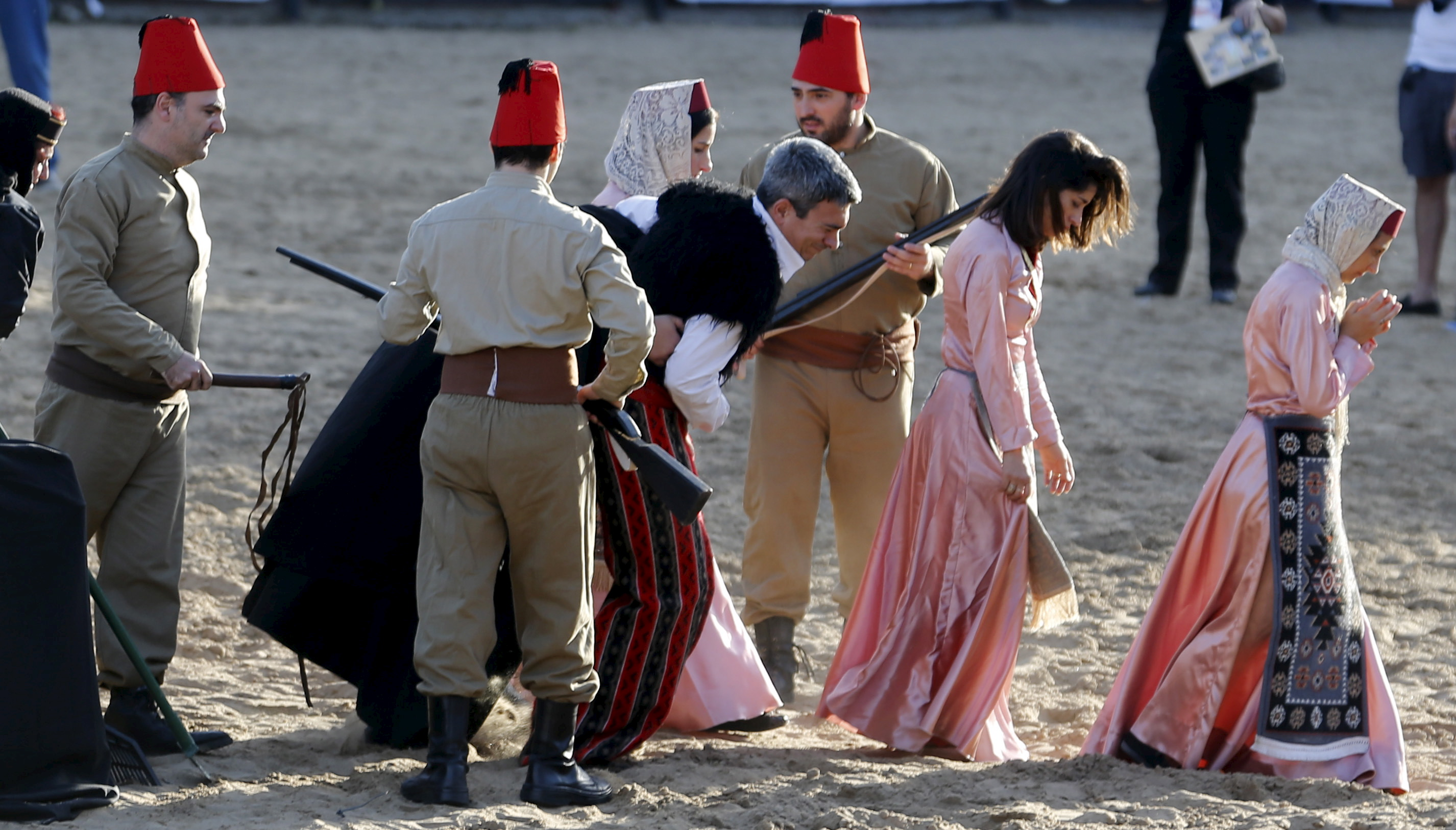 Performers reenact the capture of Armenians during a commemoration marking the 100th anniversary of the Armenian Genocide