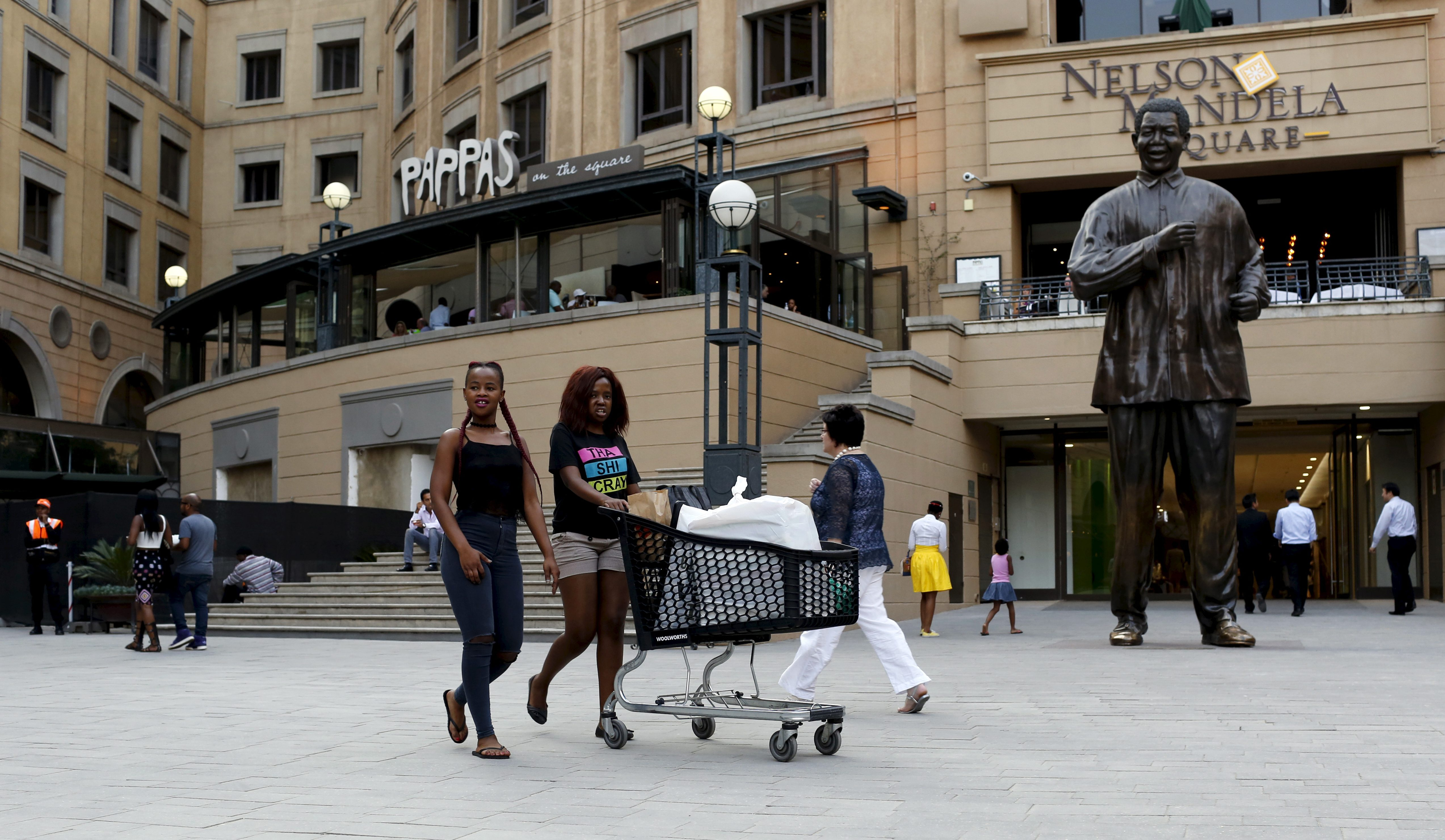 Shoppers push trolleys at an upmarket shopping mall in Sandton, Johannesburg