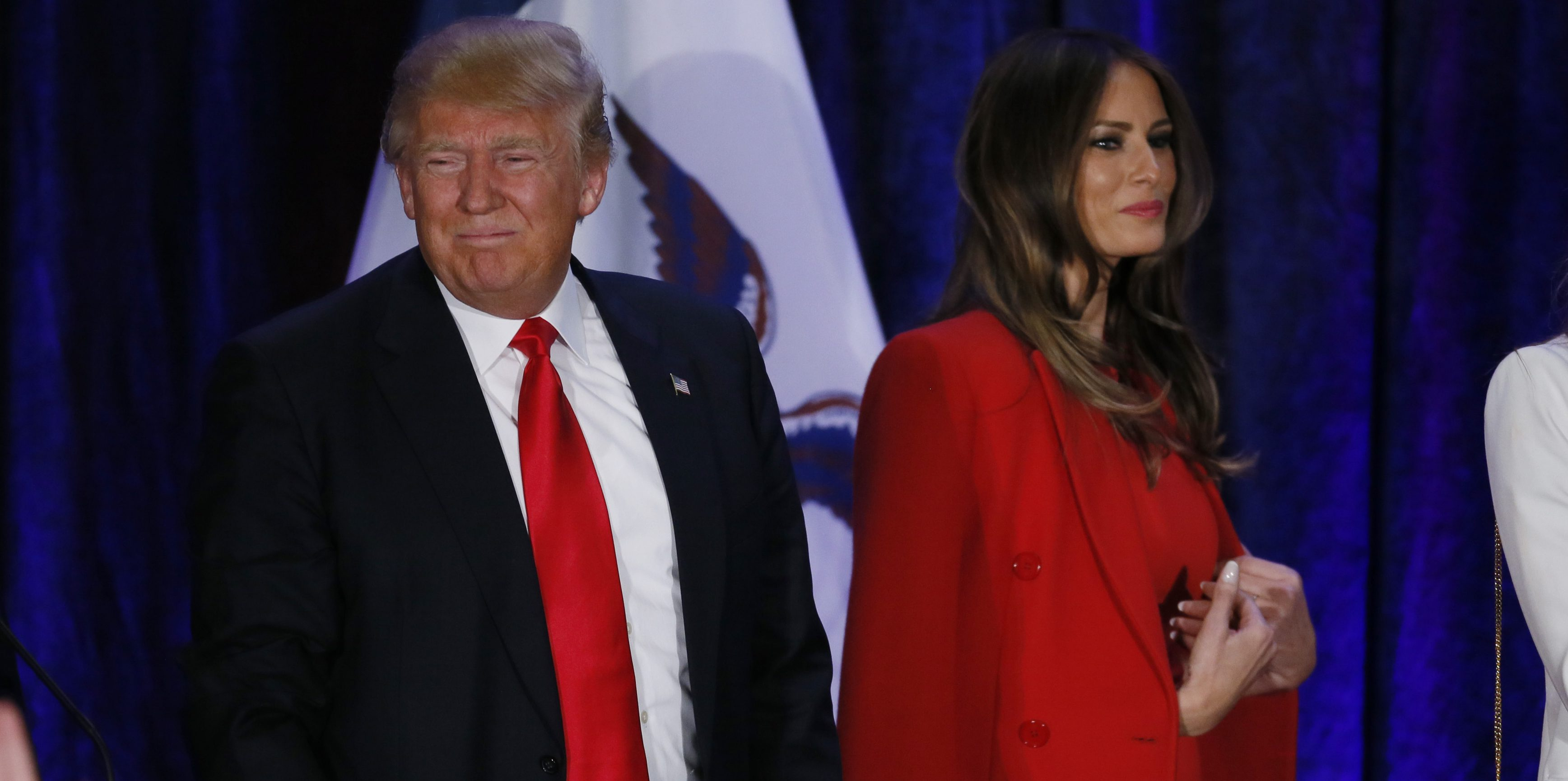 Republican U.S. presidential candidate Donald Trump and his wife Melania  leave the stage at his caucus
