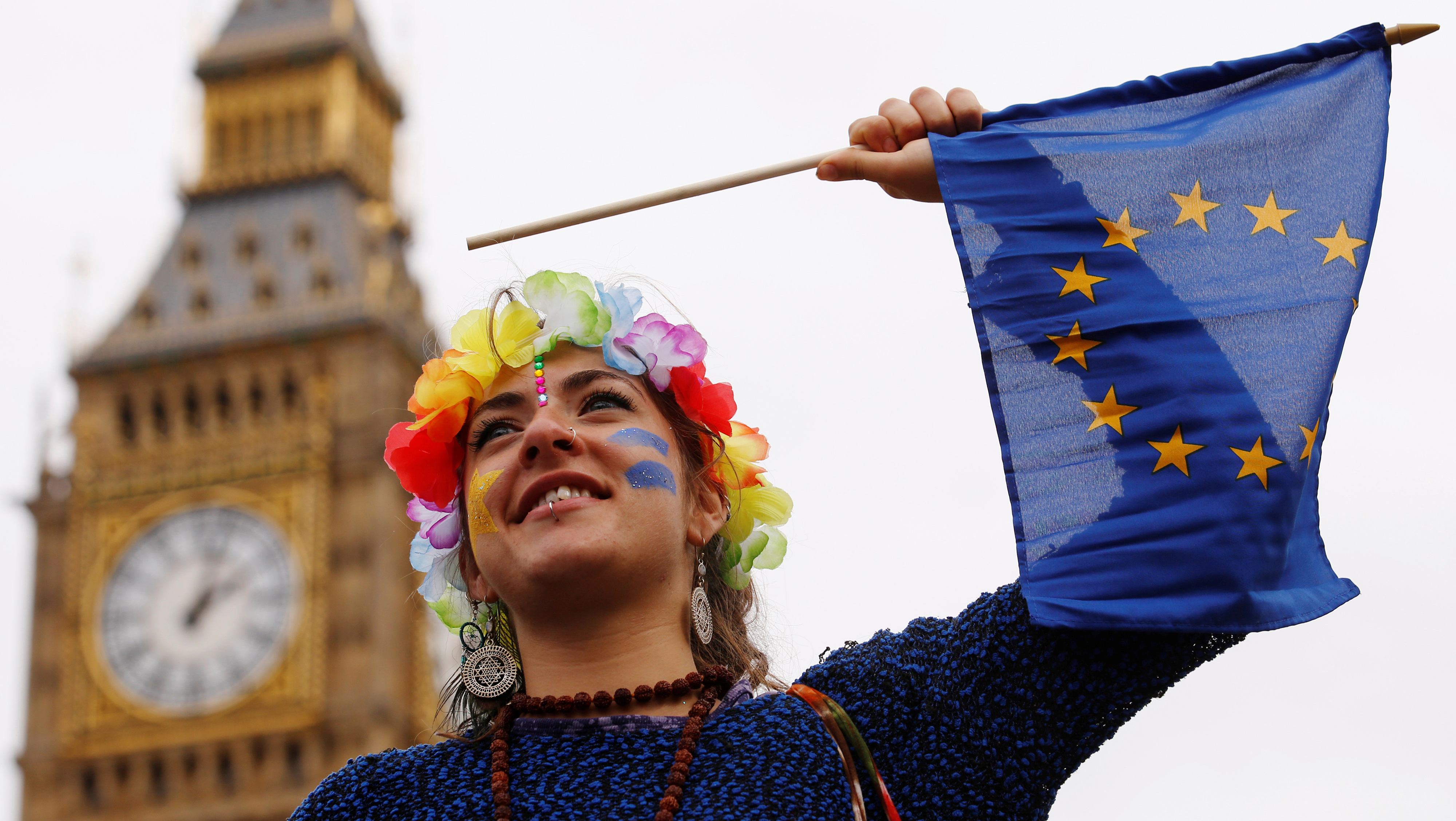 """A Pro-Europe demonstrator waves a flag during a """"March for Europe"""" protest against the Brexit vote result earlier in the year, in London, Britain, September 3, 2016.  REUTERS/Luke MacGregor   - RTX2NZUD"""