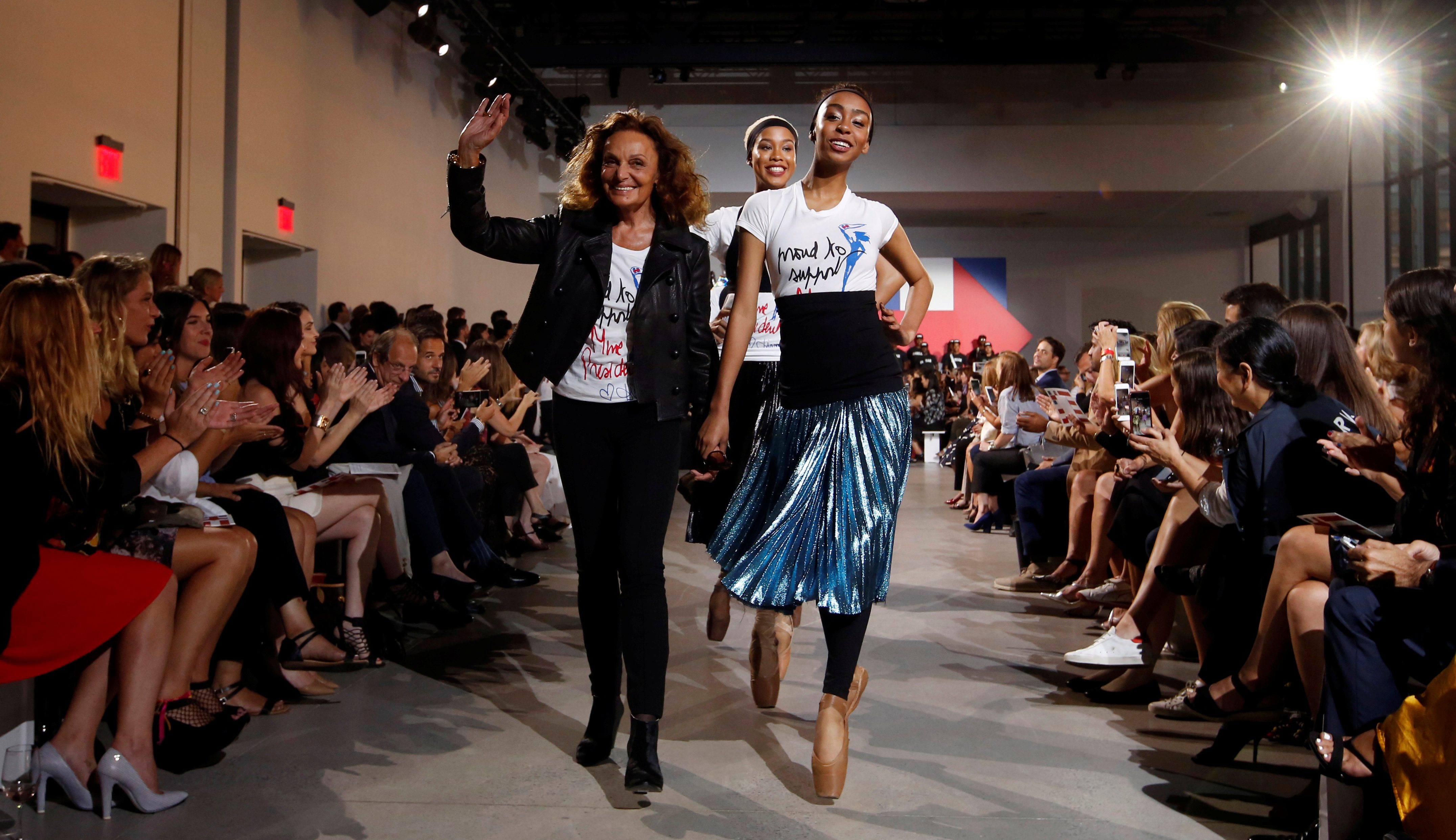 """Designer Diane von Furstenberg (L) joins models during a presentation of the """"Made for History Collection"""", supporting the campaign of Democratic presidential nominee Hillary Clinton in New York, U.S., September 6, 2016.  REUTERS/Lucas Jackson  - RTX2OF1P"""