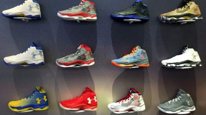 timeless design a9965 fe3cf A wall of basketball shoes is seen on display at an Under Armour store in  Chicago
