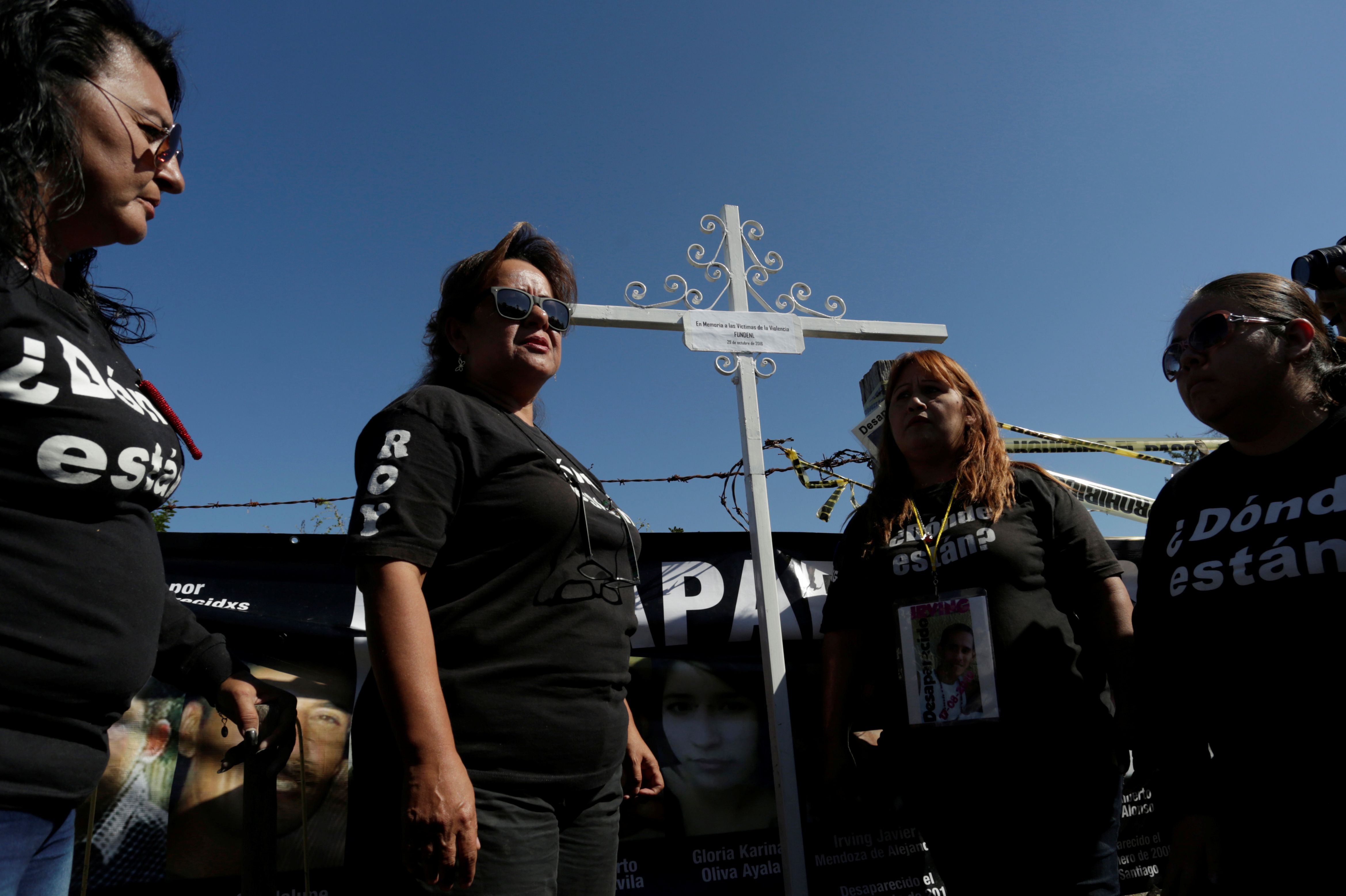 A cross in memory of the missing persons is pictured during a mass with relatives of missing persons at the site where several bodies were found in mass graves in the municipality of Salinas Victoria, Nuevo Leon, Mexico