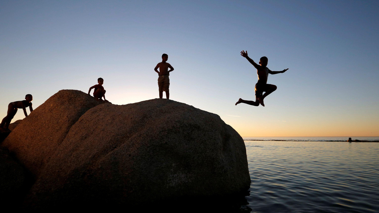 kids jumping off rock